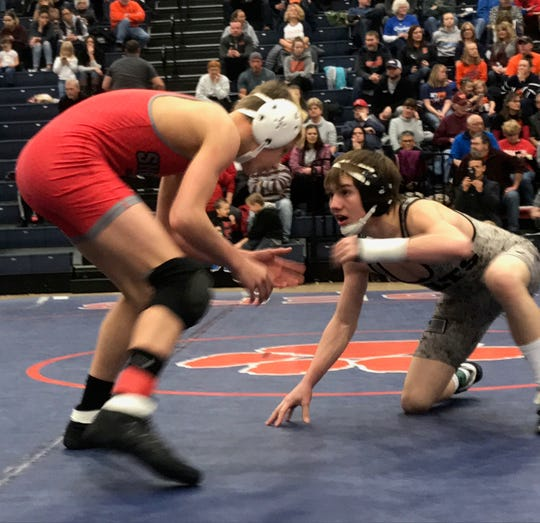 Clear Fork's Colton Campbell gets ready to pounce from his knees against Shelby's Garrett Baker in the 113-pound finals of the Mid-Ohio Athletic Conference meet. Campbell won his second MOAC title with 12-1 decision.