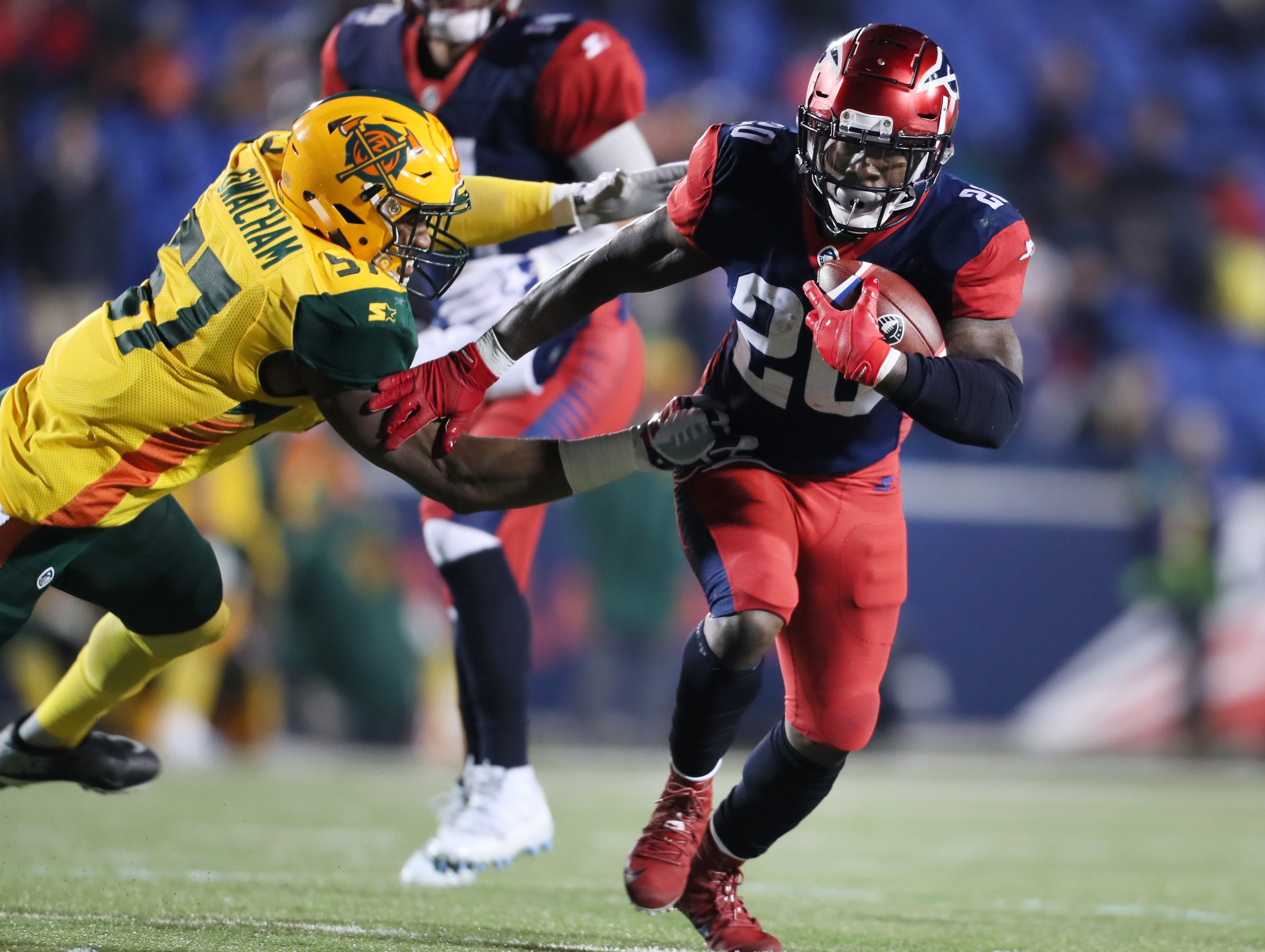 Memphis Express running back Zac Stacy breaks away from Arizona Hotshots linebacker Obum Gwacham during their game at the Liberty Bowl on Saturday, Feb. 16, 2019.