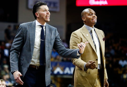 Memphis assistant coach Mike Miller (left) and head coach Penny Hardaway (right) direct their players during action against UCF in Orlando Saturday, February 16, 2019.