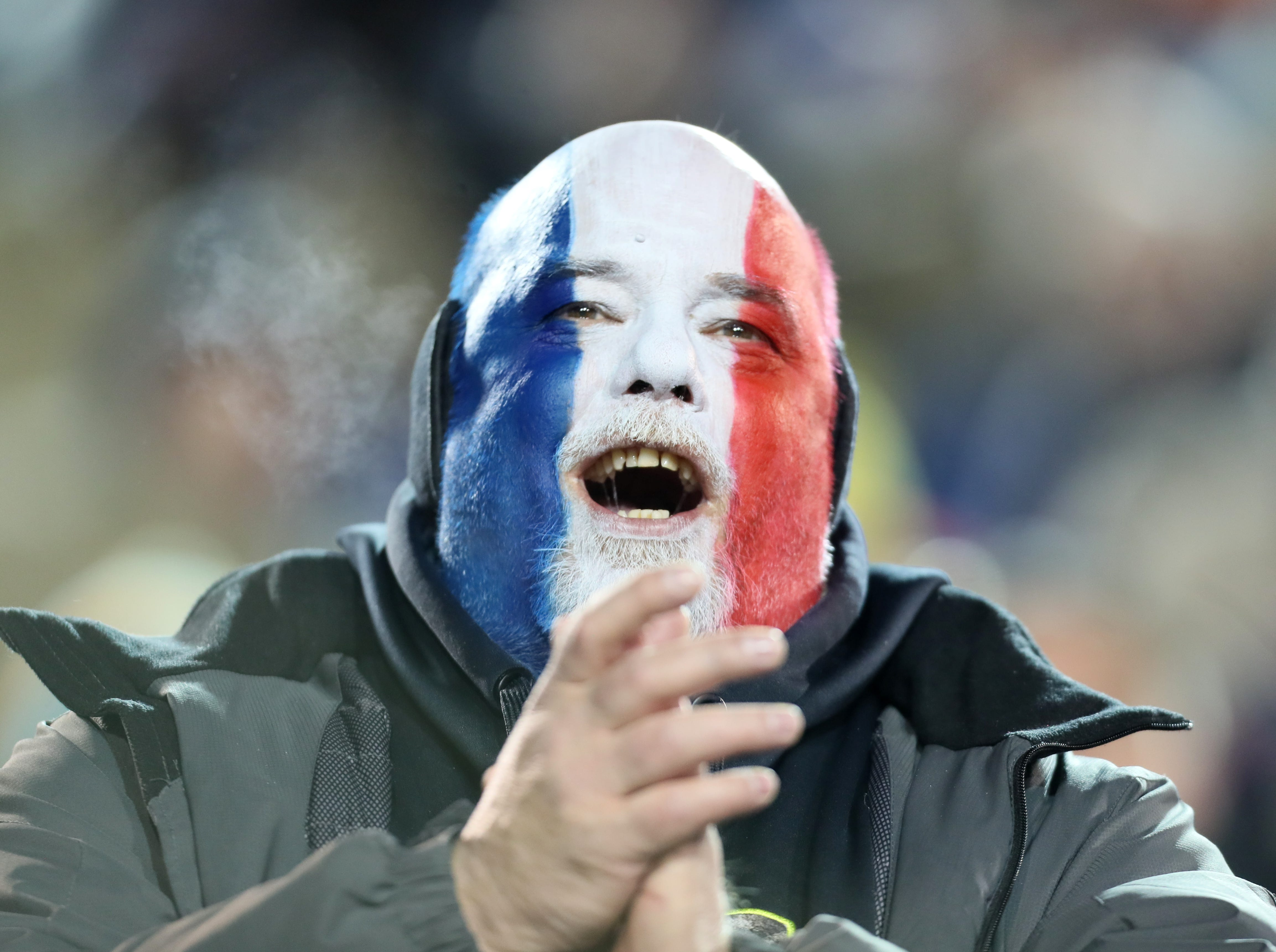 A Memphis Express fan cheers on his team as they take on the Arizona Hotshots at the Liberty Bowl on Saturday, Feb. 16, 2019.