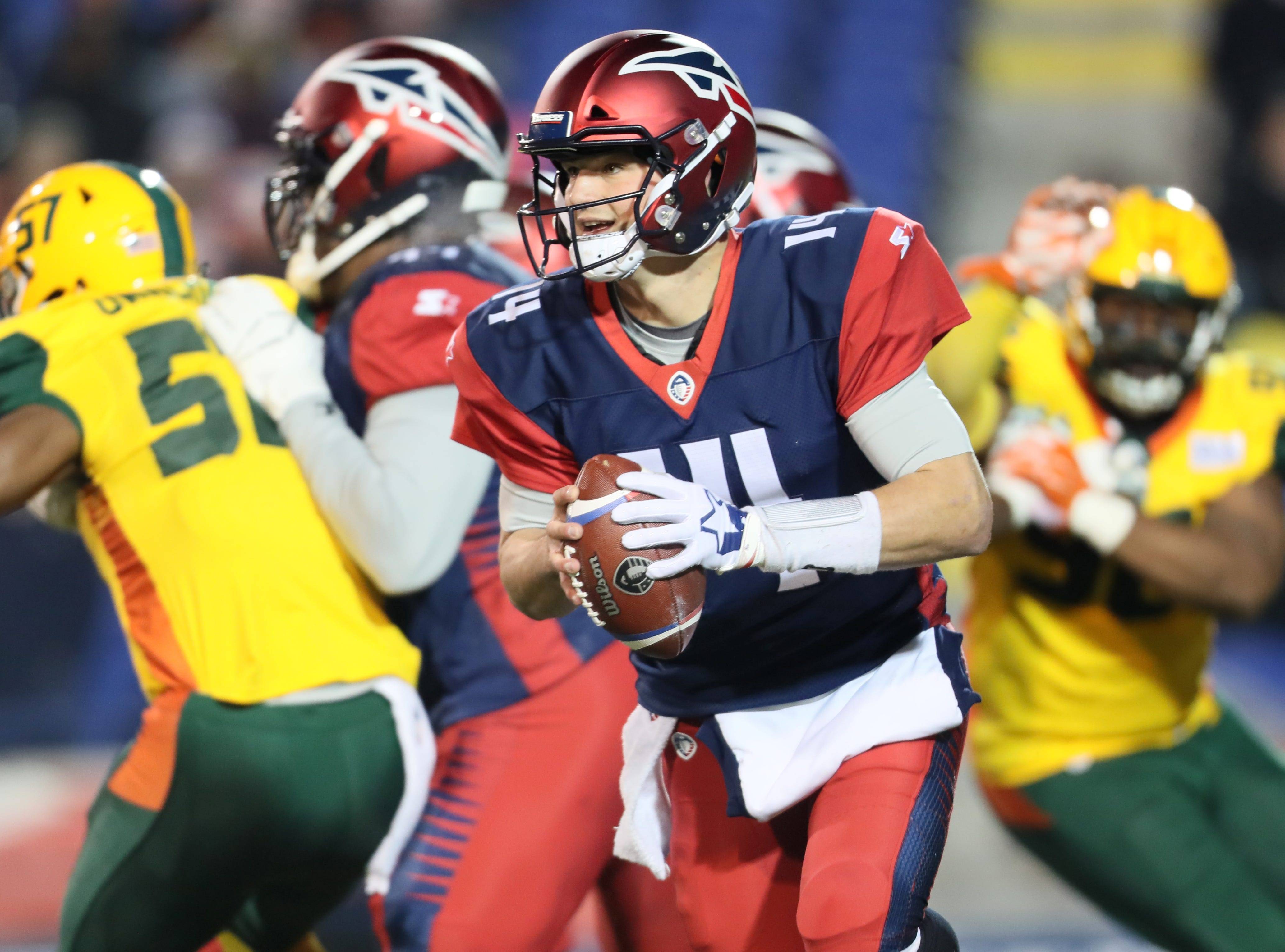 Memphis Express quarterback Christian Hackenberg scrambles out of the pocket against the Arizona Hotshots defense during their game at the Liberty Bowl on Saturday, Feb. 16, 2019.