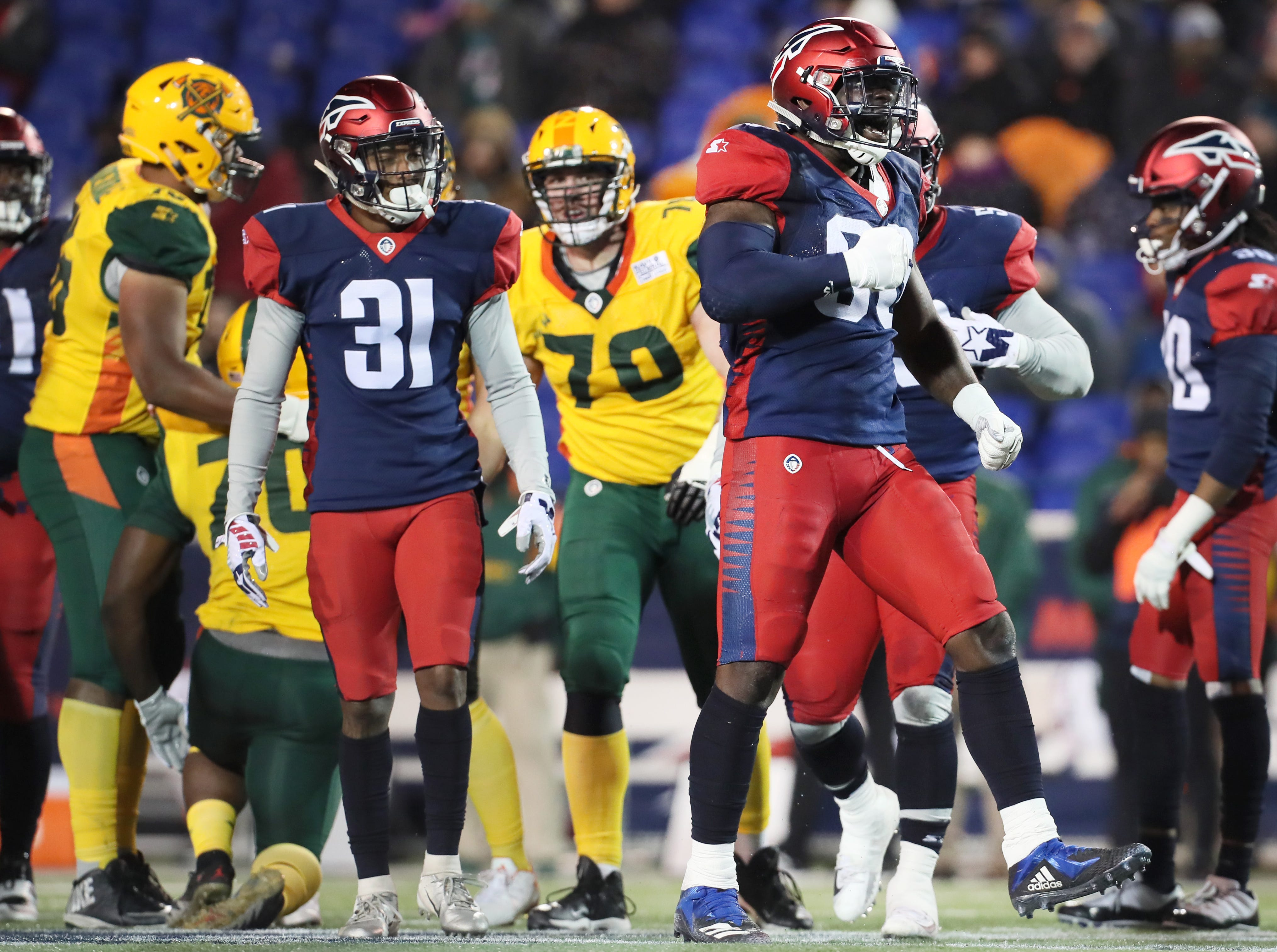 Memphis Express linebacker Anthony Johnson celebrates a tackle against the Arizona Hotshots during their game at the Liberty Bowl on Saturday, Feb. 16, 2019.