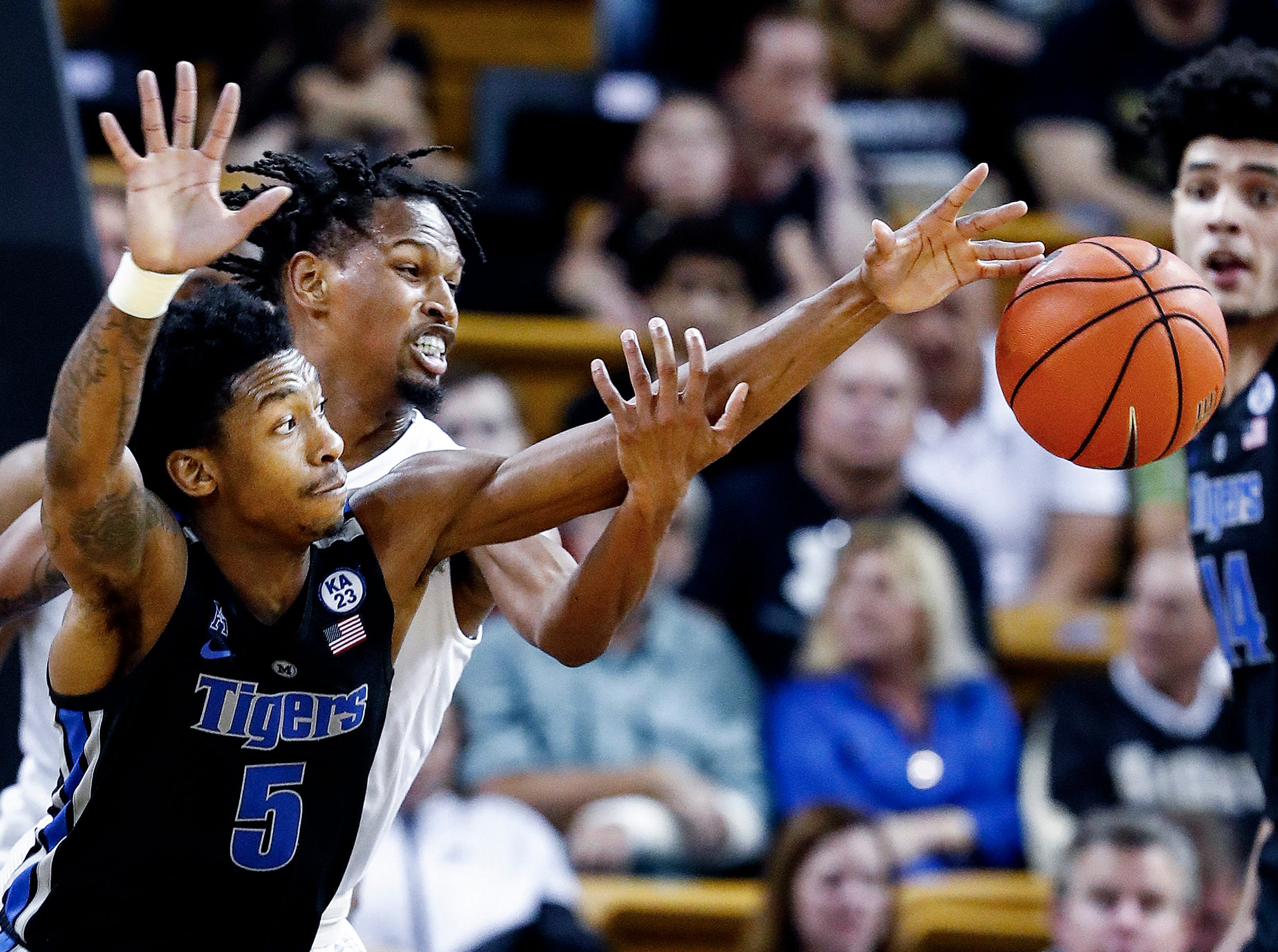 Memphis defender Kareem Brewton Jr. (front) grabs a loose ball away from UCF guard Terrell Allen (back) during action in Orlando Saturday, February 16, 2019.