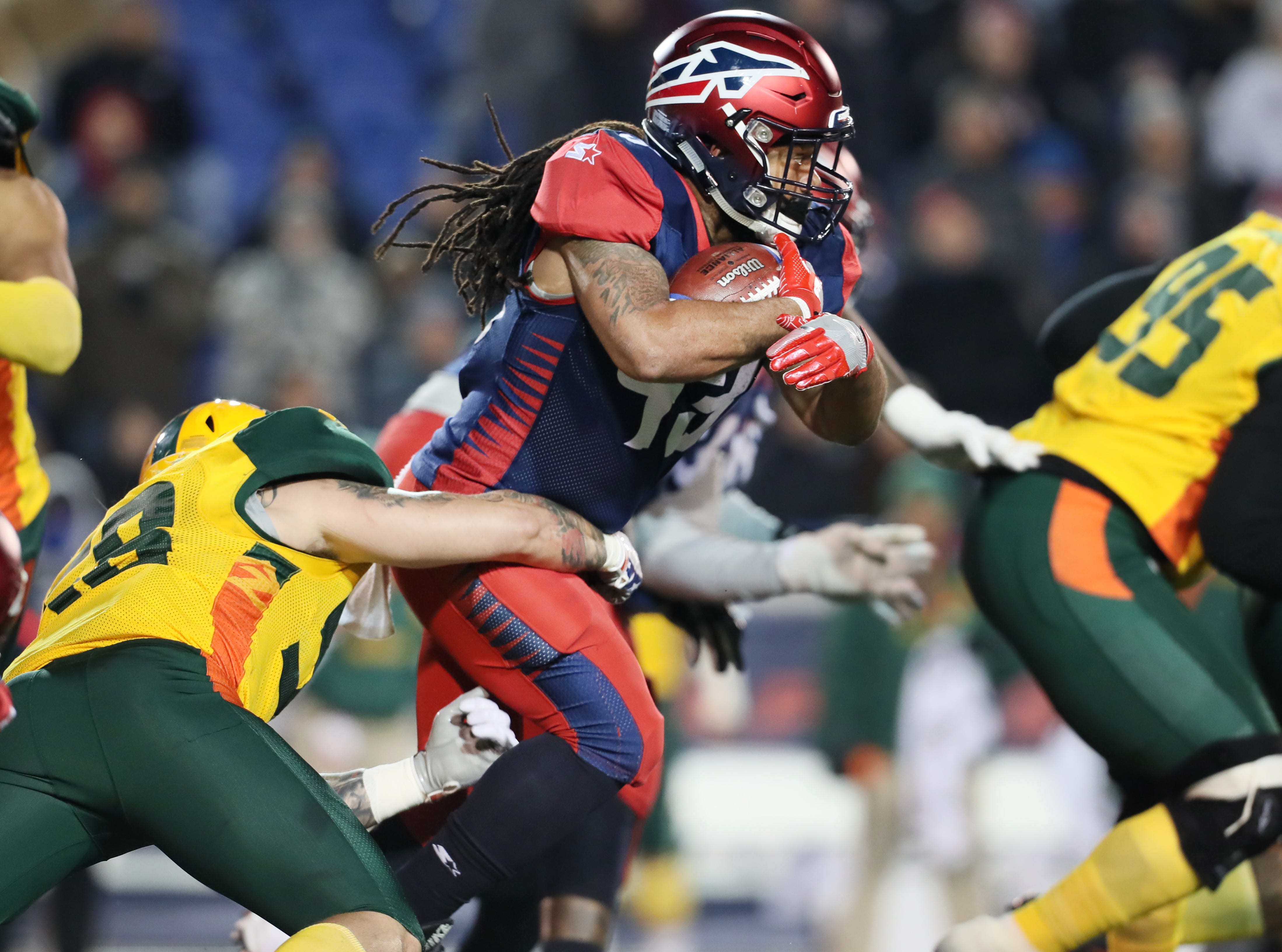 Memphis Express running back Terrence Magee breaks away from Arizona Hotshots defender Terrence Magee during their game at the Liberty Bowl on Saturday, Feb. 16, 2019.