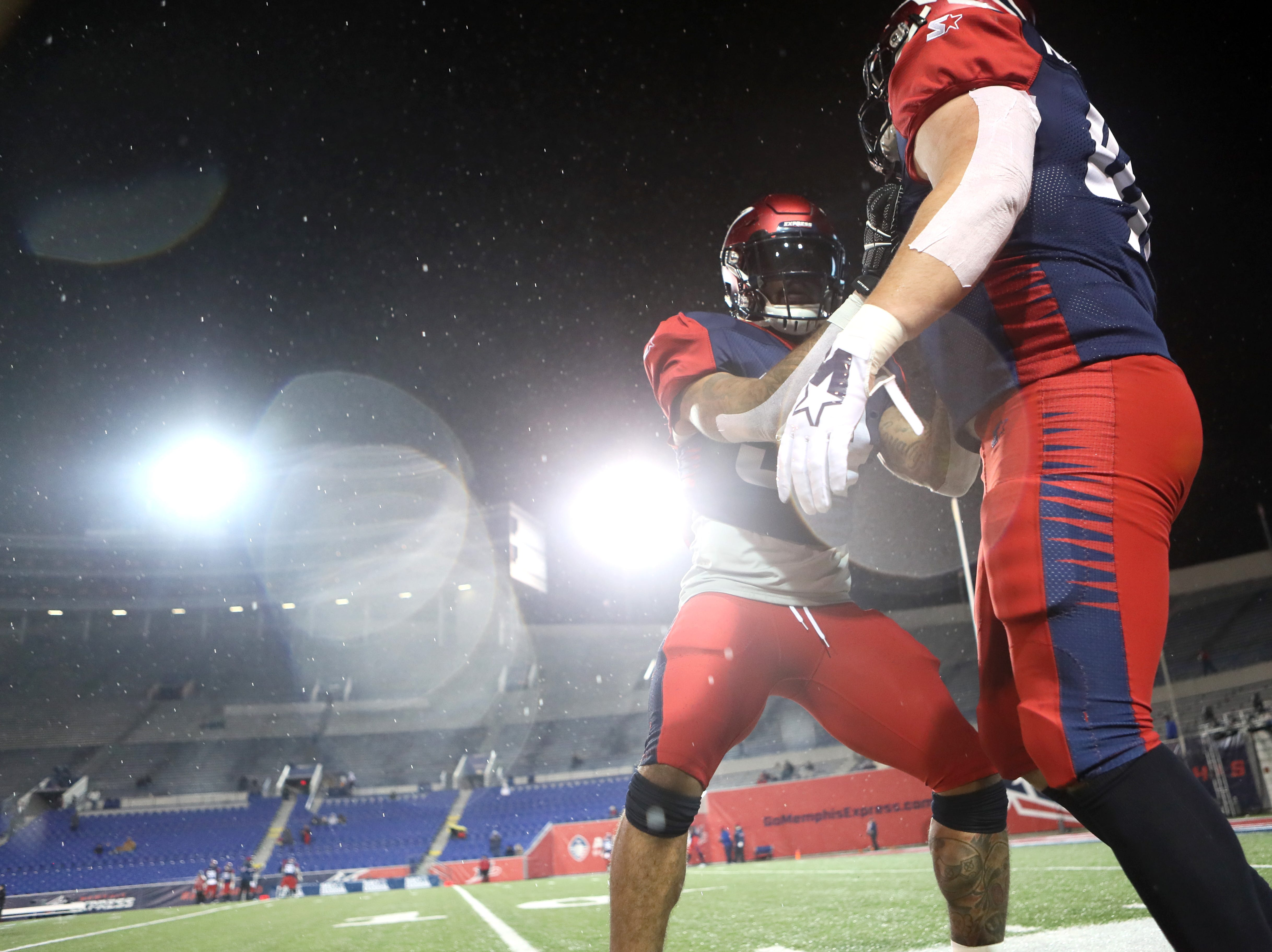 Memphis Express running backs Rajion Neal, center, and Anthony Manzo-Lewis warm up before their game atgainst the Arizona Hotshots at the Liberty Bowl on Saturday, Feb. 16, 2019.