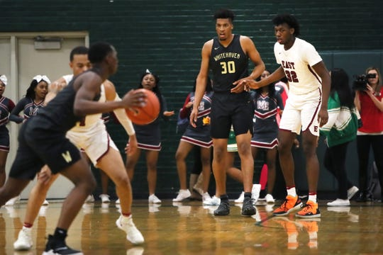 """Whitehaven's Jordan Wilmore, who at 7'2"""" stands more than a foot taller than most of his teammates, is guarded by fellow seven-footer James Wiseman at Memphis Central High School Friday, Feb. 15, 2019."""