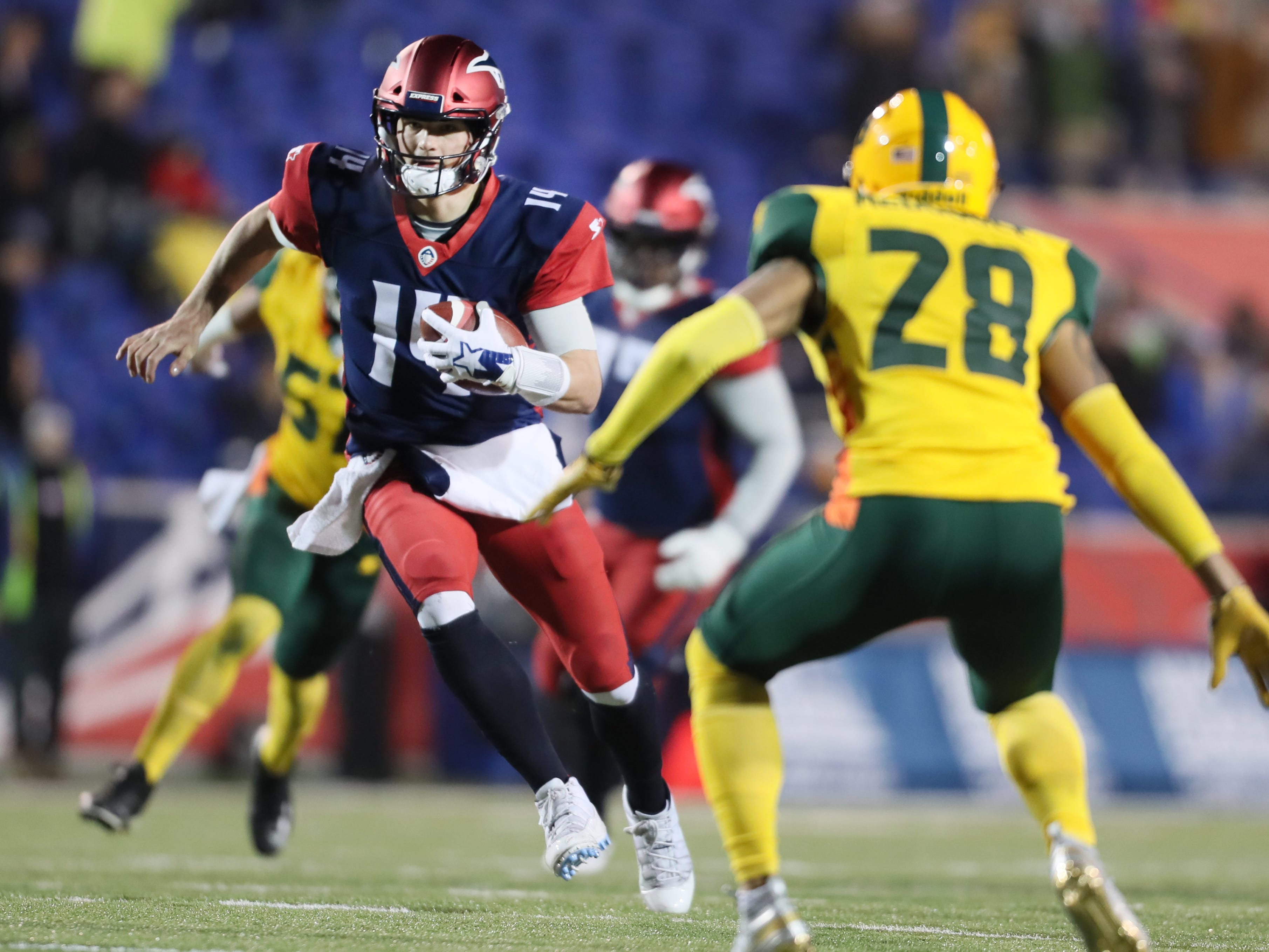 Memphis Express quarterback Christian Hackenberg scrambles out of the pocket against the Arizona Hotshots during their game at the Liberty Bowl on Saturday, Feb. 16, 2019.