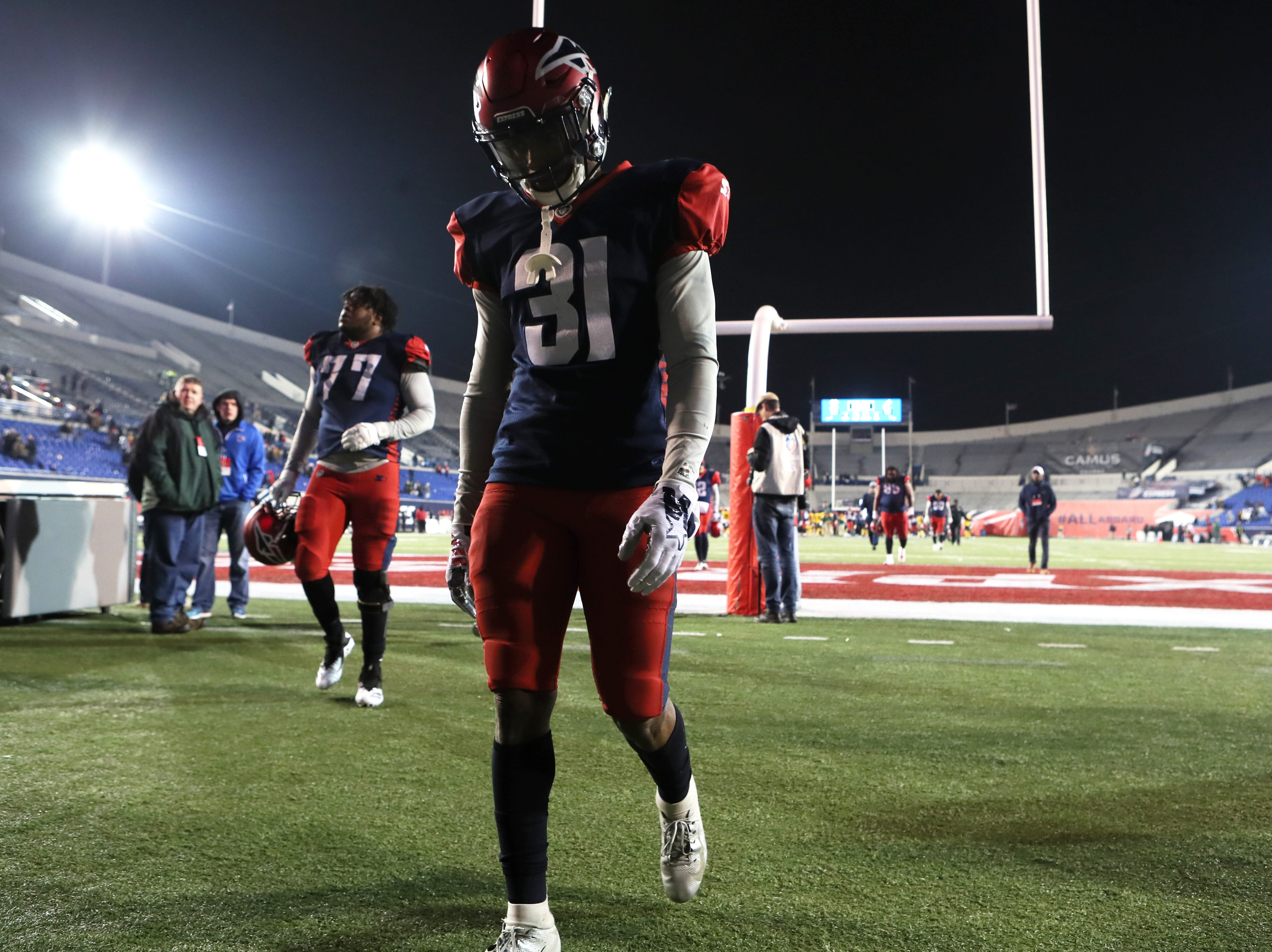 Memphis Express defensive back Jonathan Cook walks off the field after their 20-18 loss to the Arizona Hotshots at the Liberty Bowl on Saturday, Feb. 16, 2019.