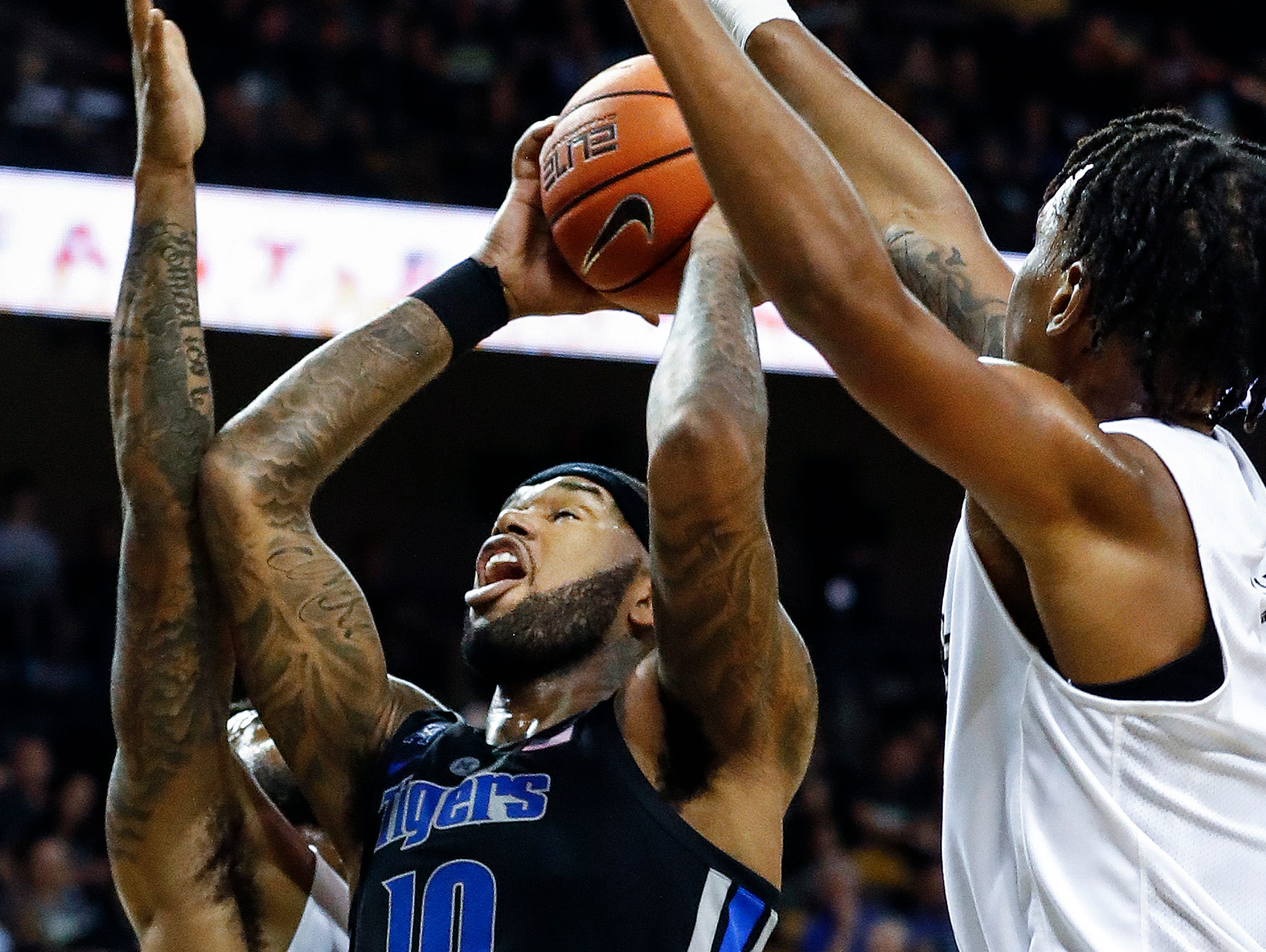 Memphis forward Mike Parks Jr. (middle) grabs a rebound in front of UCF defenders Dayon Griffin (left) and Terrell Allen (right) during action in Orlando Saturday, February 16, 2019.