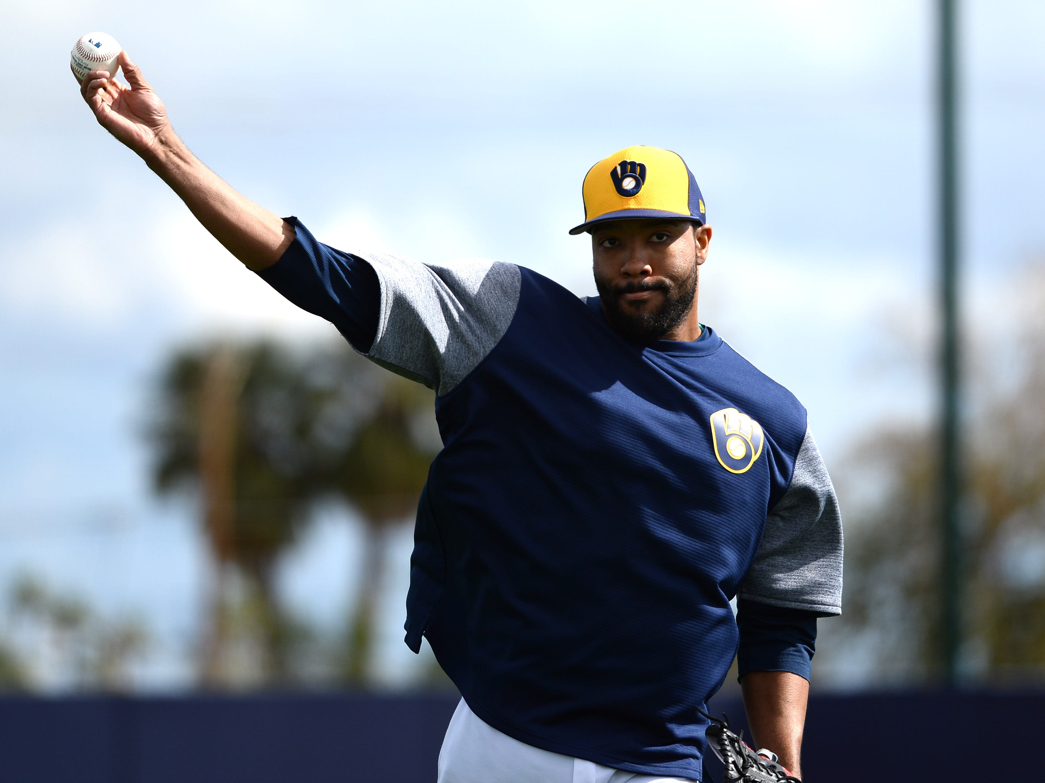 Relief pitcher Jay Jackson throws home during drills Saturday.