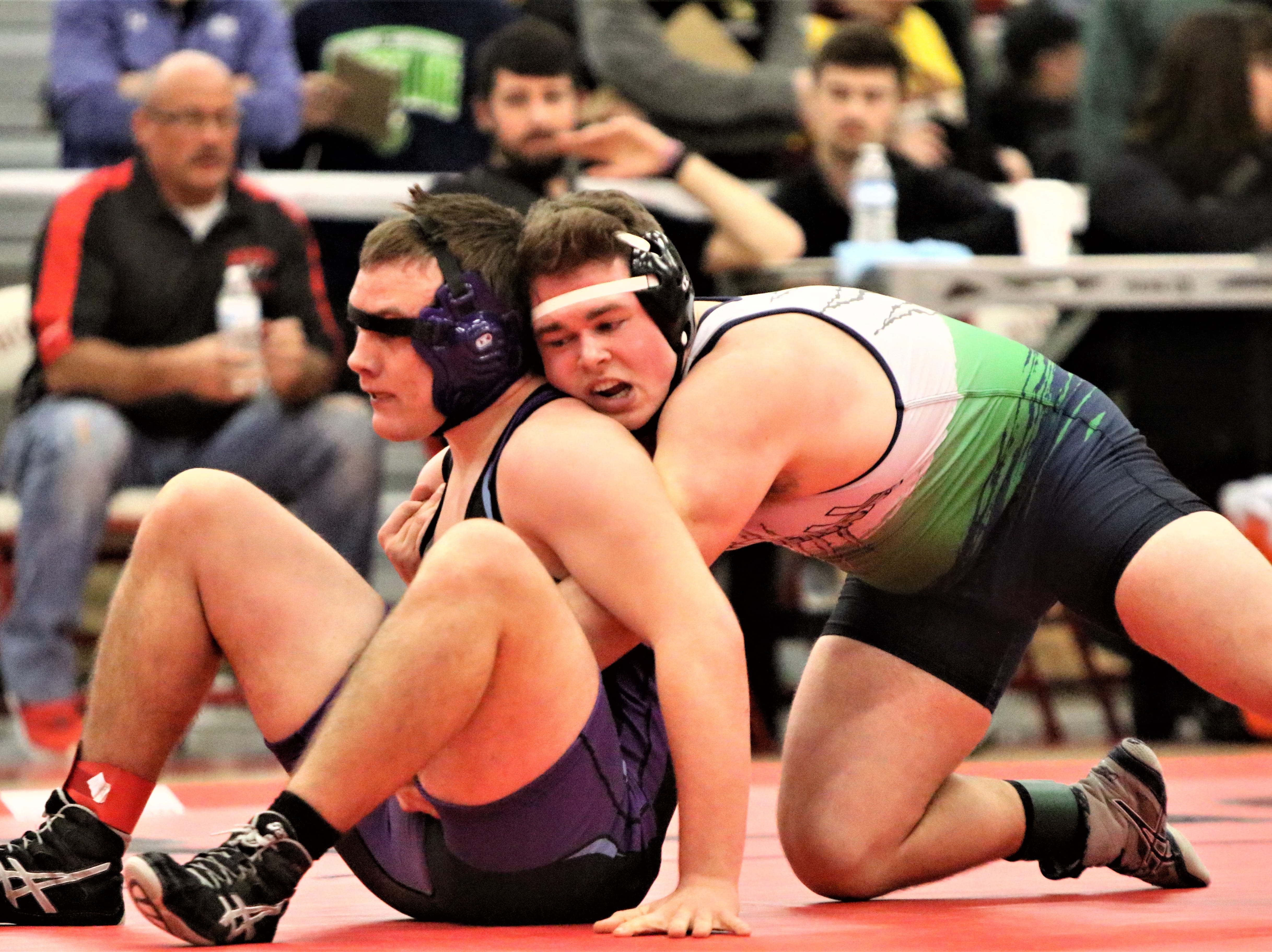 Whitnall/Greendale's Brandt Hausch (right) grabs a hold of Waukesha North's Josh Schultz during the WIAA sectional meet at Racine Horlick on Feb. 16, 2019.