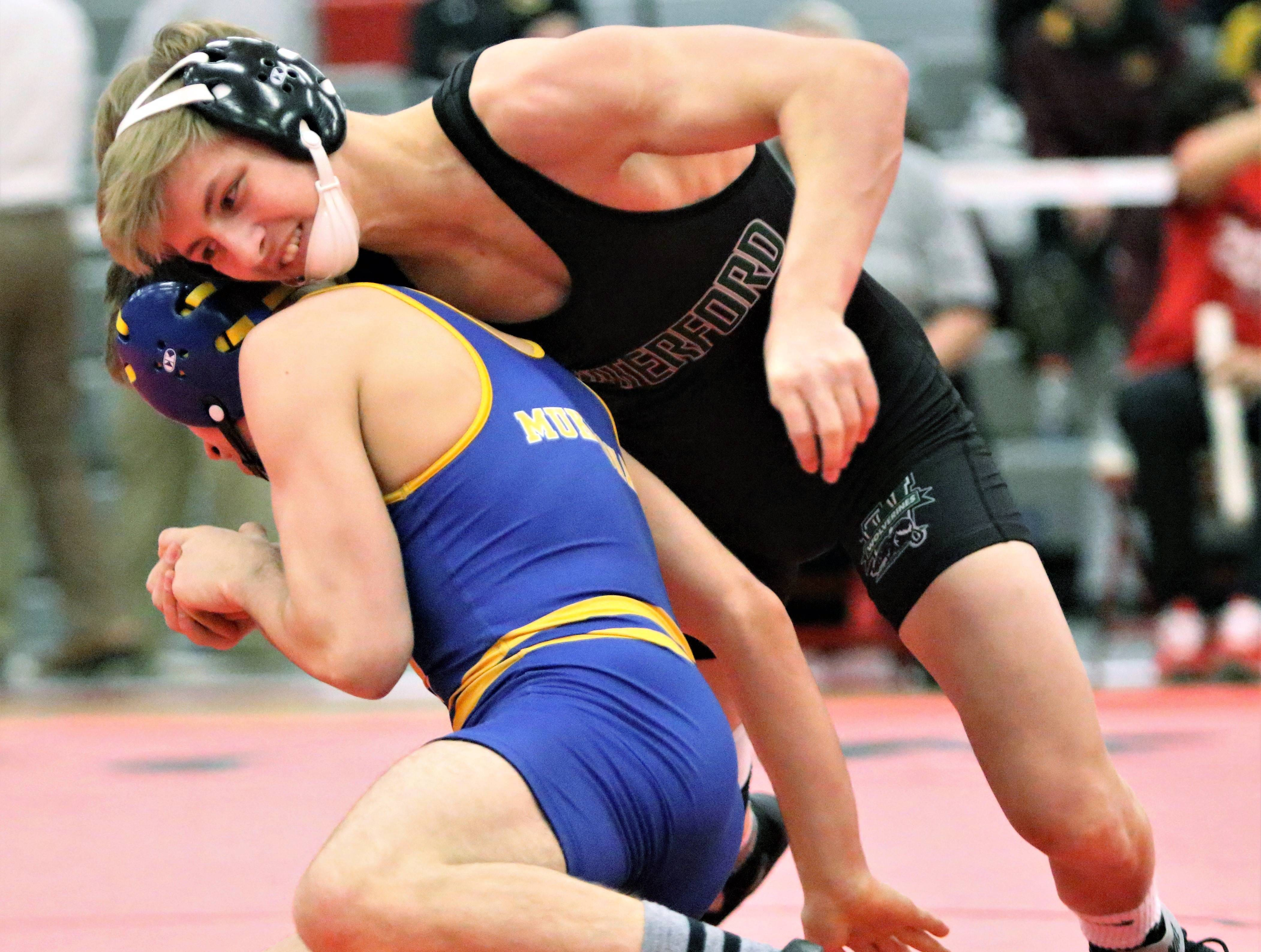 Waterford's Hayden Halter competes against Mukwonago's Jacob Wisinski during a sectional match at Racine Horlick on Feb. 16, 2019.