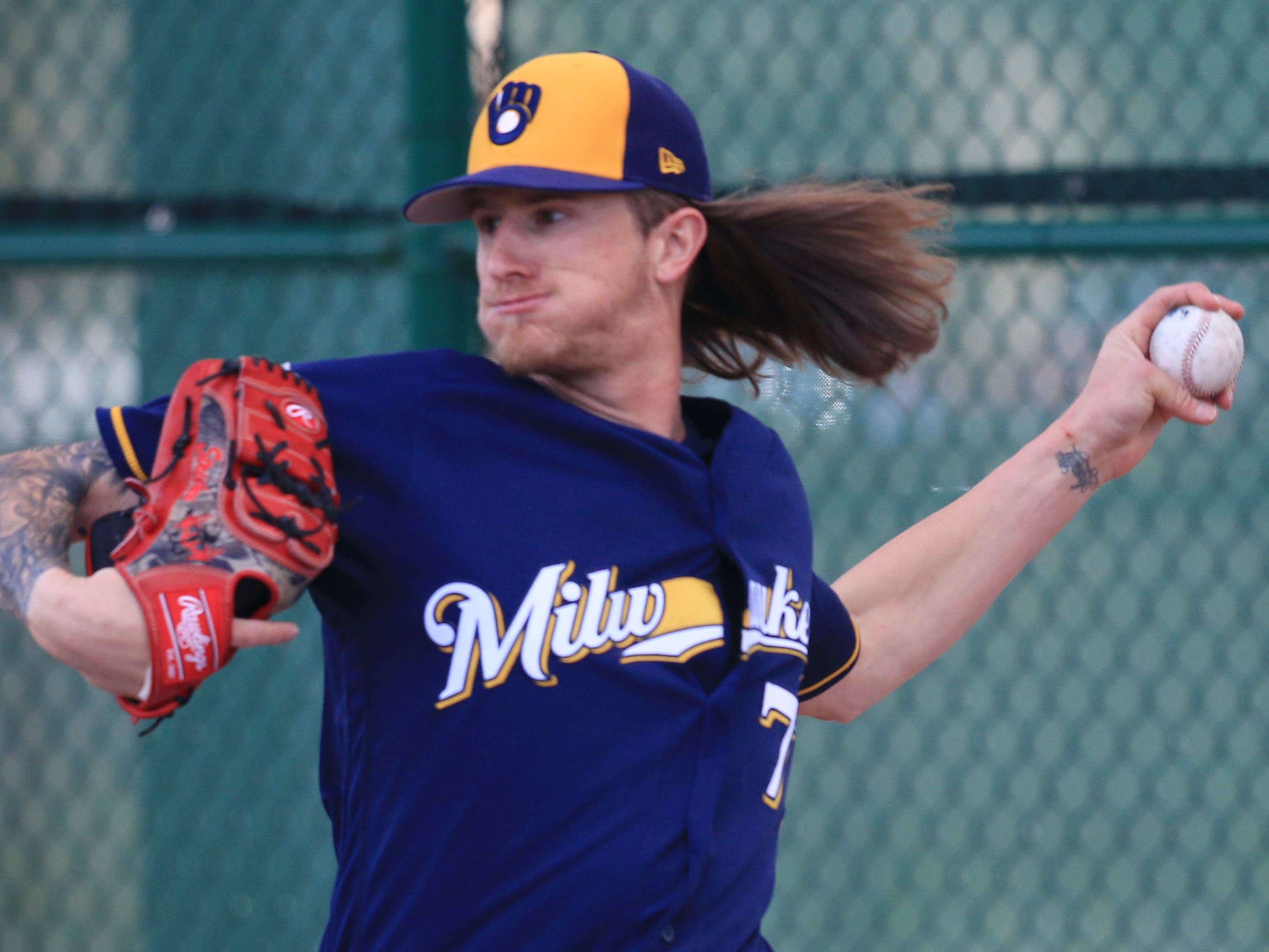 Brewers pitcher Josh Hader gets ready to uncork a pitch during a bullpen session Saturday.