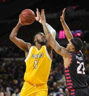 UW-Milwaukee forward Vance Johnson (shown in an earlier game) had 25 points and nine rebounds on Saturday.