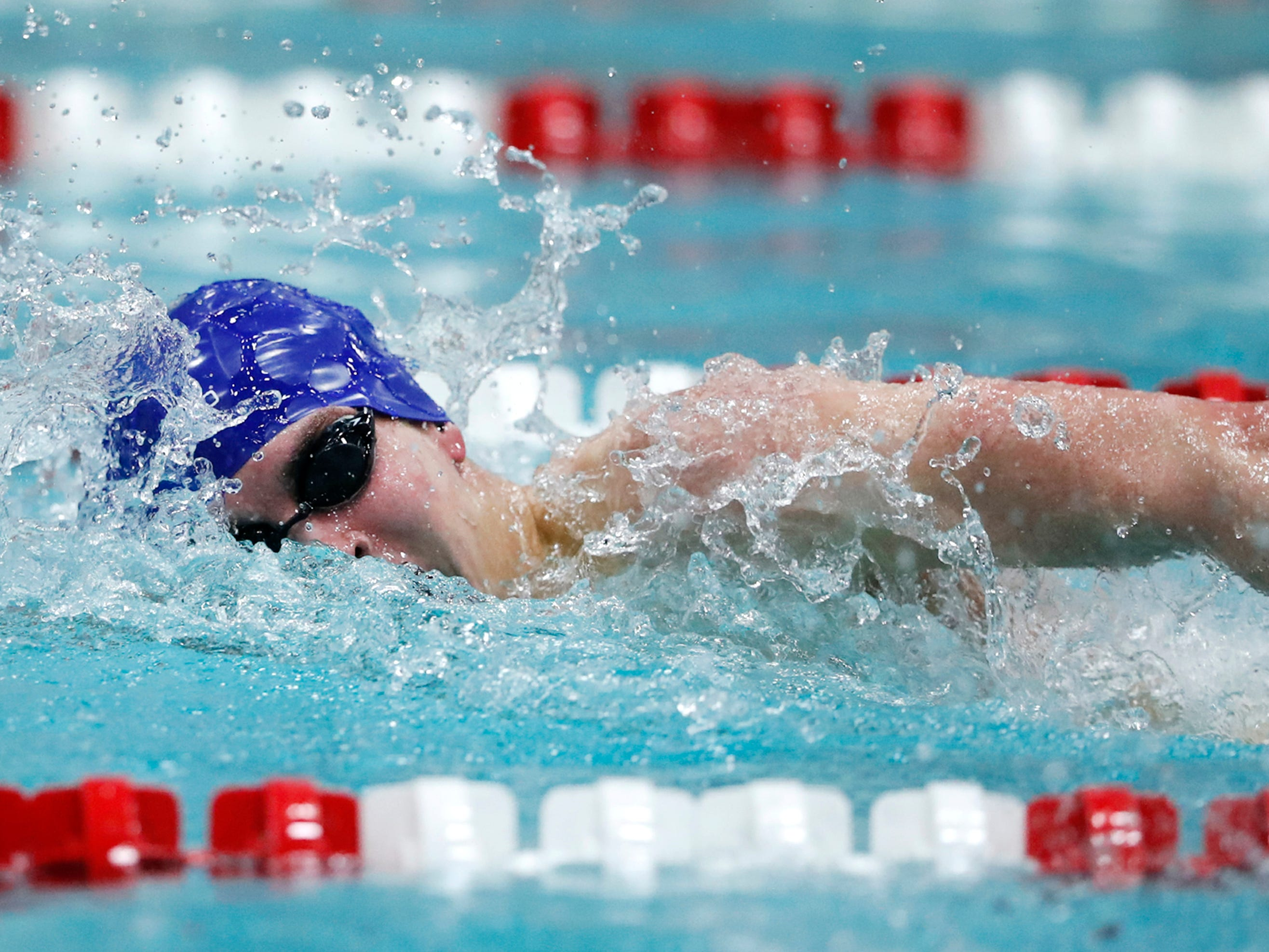 Brookfield Central/East junior Michael Linnihan swims to victory in the 200 yard freestyle Saturday  at the WIAA Division 1 state meet.