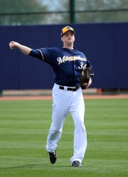 Pitcher Jake Petricka warms up with a game of catch before practice Saurday.