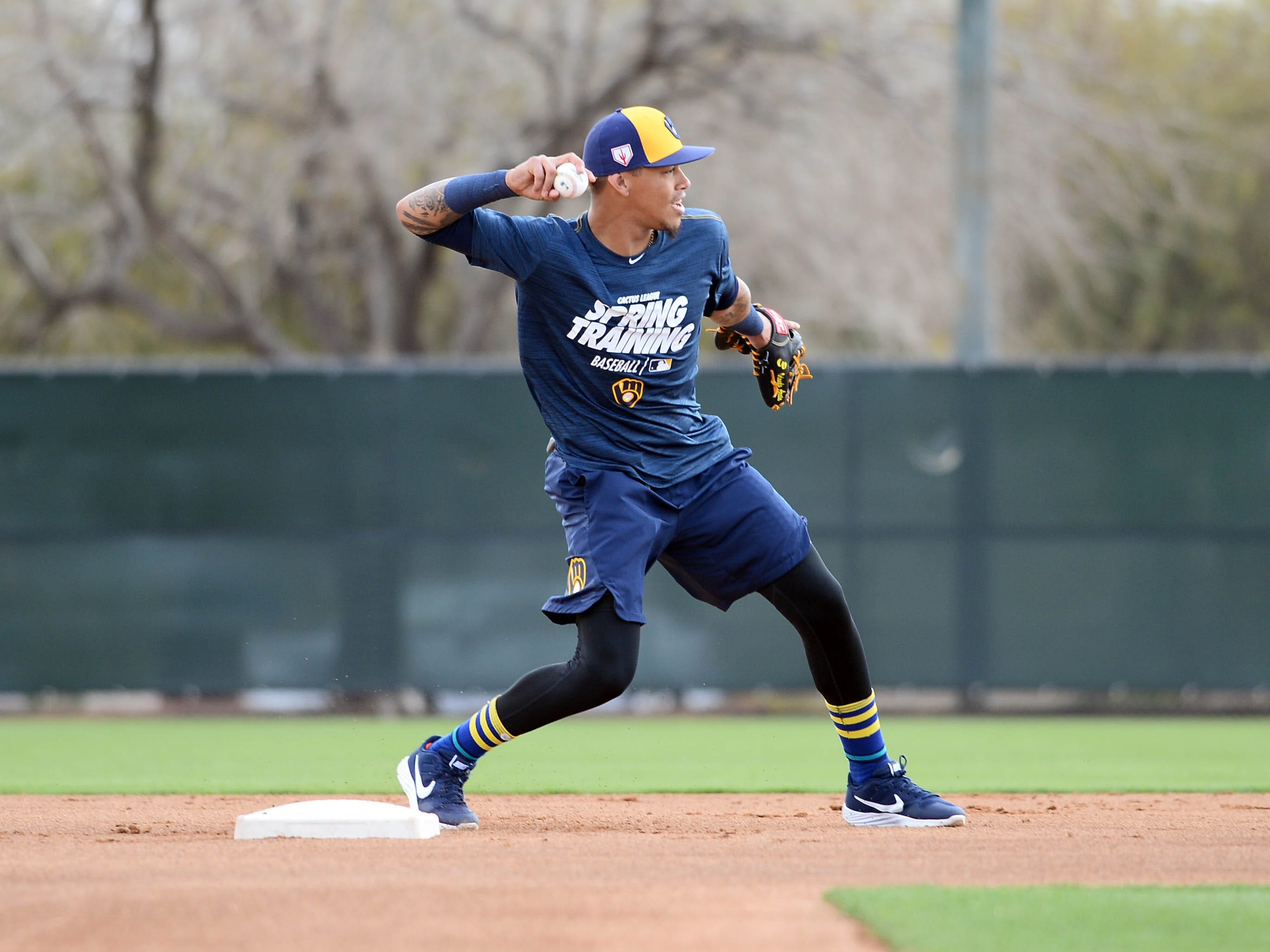 Brewers shortstop Orlando Arcia gets ready to flip a throw to first during fielding drills Satruday.