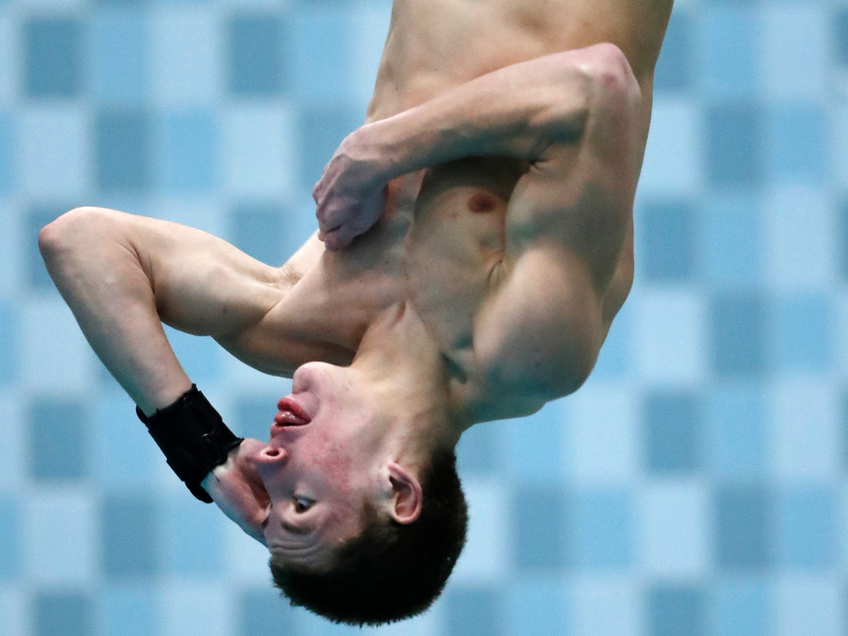 Brookfield Central/East's Braden Rumpit performs a dive with twists and flips involved Saturday at the WIAA Division 1 state meet.