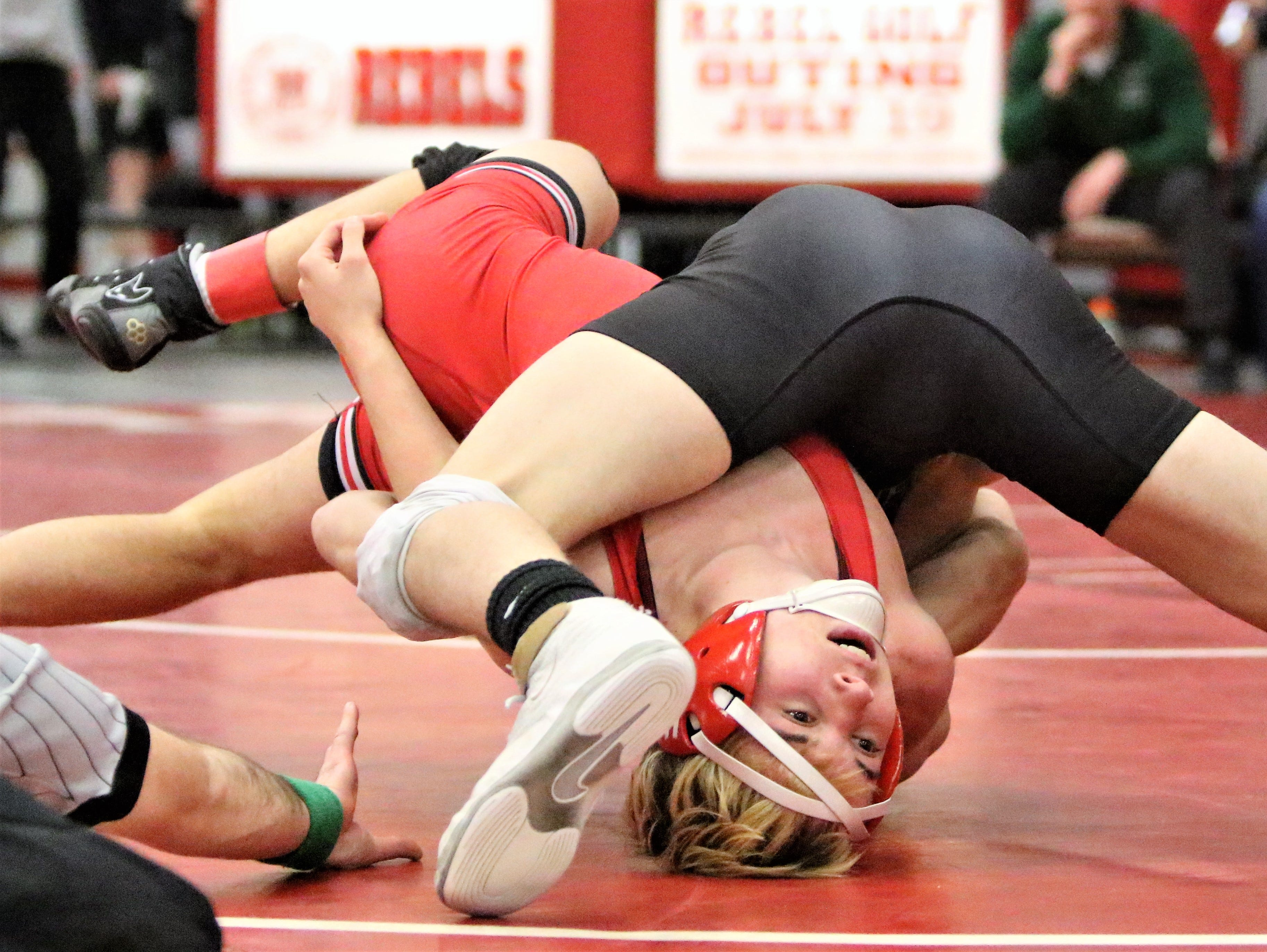 Muskego's Alex Wintheiser attempts to escape the hold of Waterford's Joshua Cherba during a WIAA sectional match on Feb. 16, 2019.