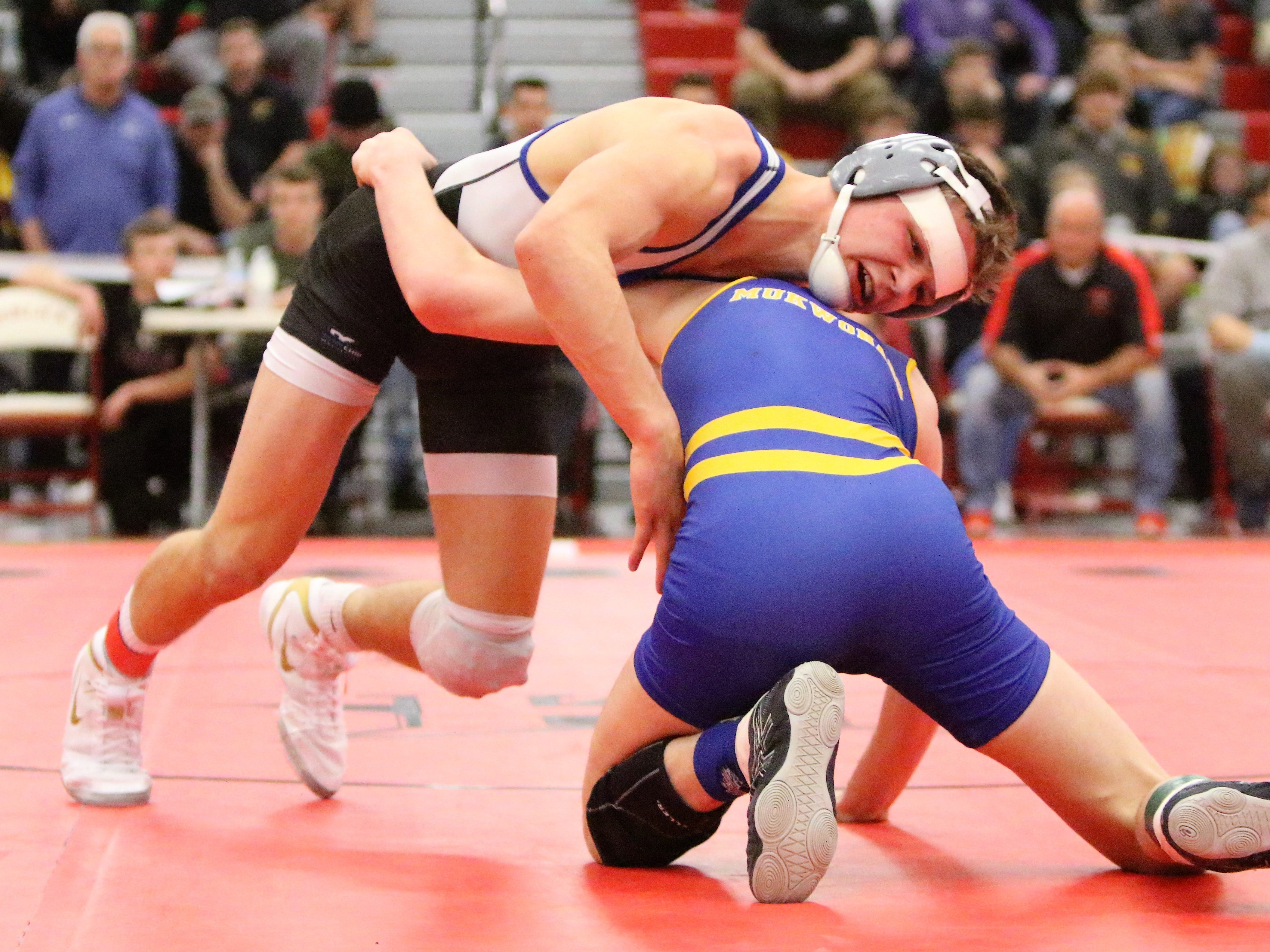 Waukesha West's CJ Grisar wrestles against Mukwonago's Josiah Lynden in the 132-pound sectional title match at Racine Horlick on Feb. 16, 2019.