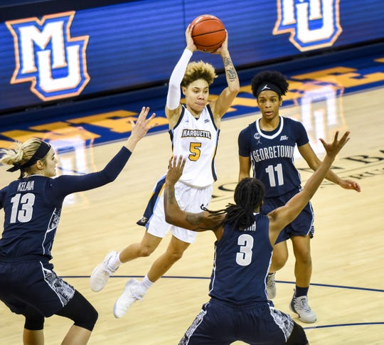 Marquette guard Natisha Hiedeman passes across the lane against Georgetown in a Big East women's college basketball game Friday, February 8, 2019, at the Al McGuire Center on the Marquette University Campus.