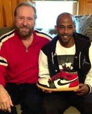 Larry Awe (left) found a rare Michael Jordan shoe in a dumpster in 2001. He and future son-in-law Donald Griffin (right) are putting it to auction.