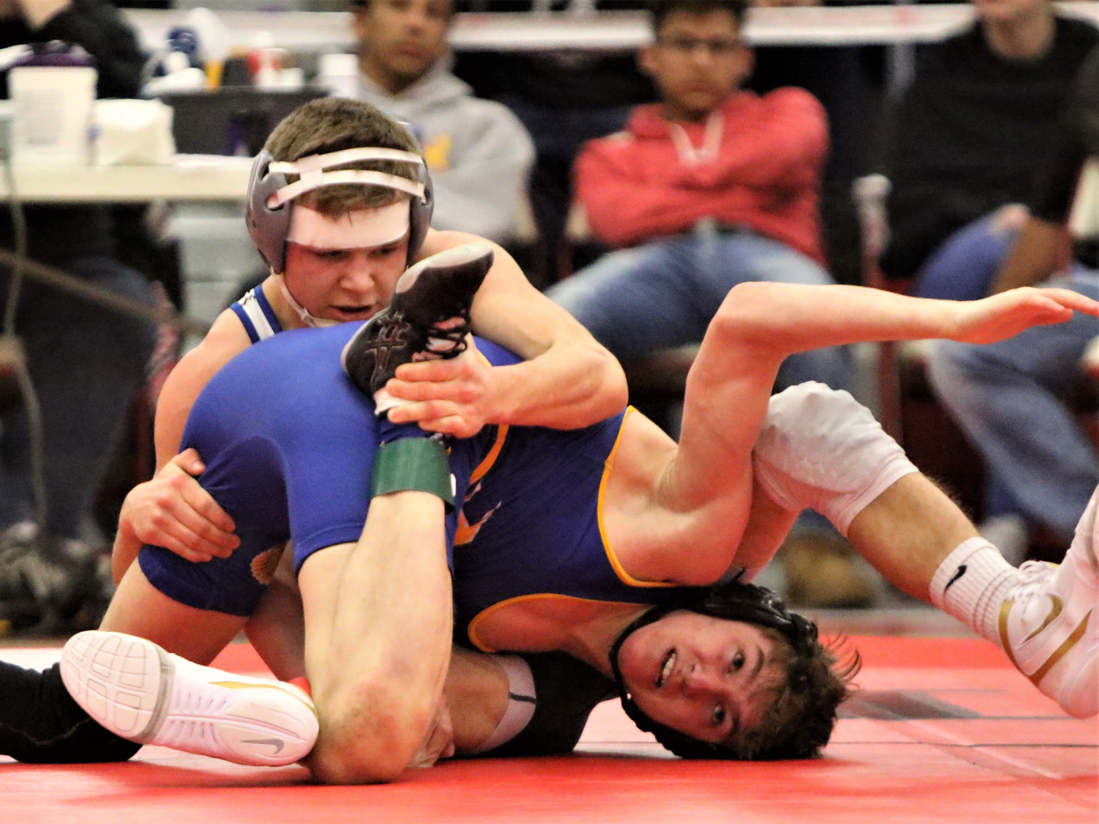 Mukwonago's CJ Grisar (back) grabs hold of Mukwonago's Josiah Lynden during a sectional title match at Racine Horlick on Feb. 16, 2019.