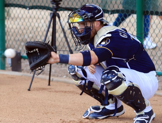 Catcher Yasmani Grandal gets ready to receive a pitch during a bullpen session on Saturday.