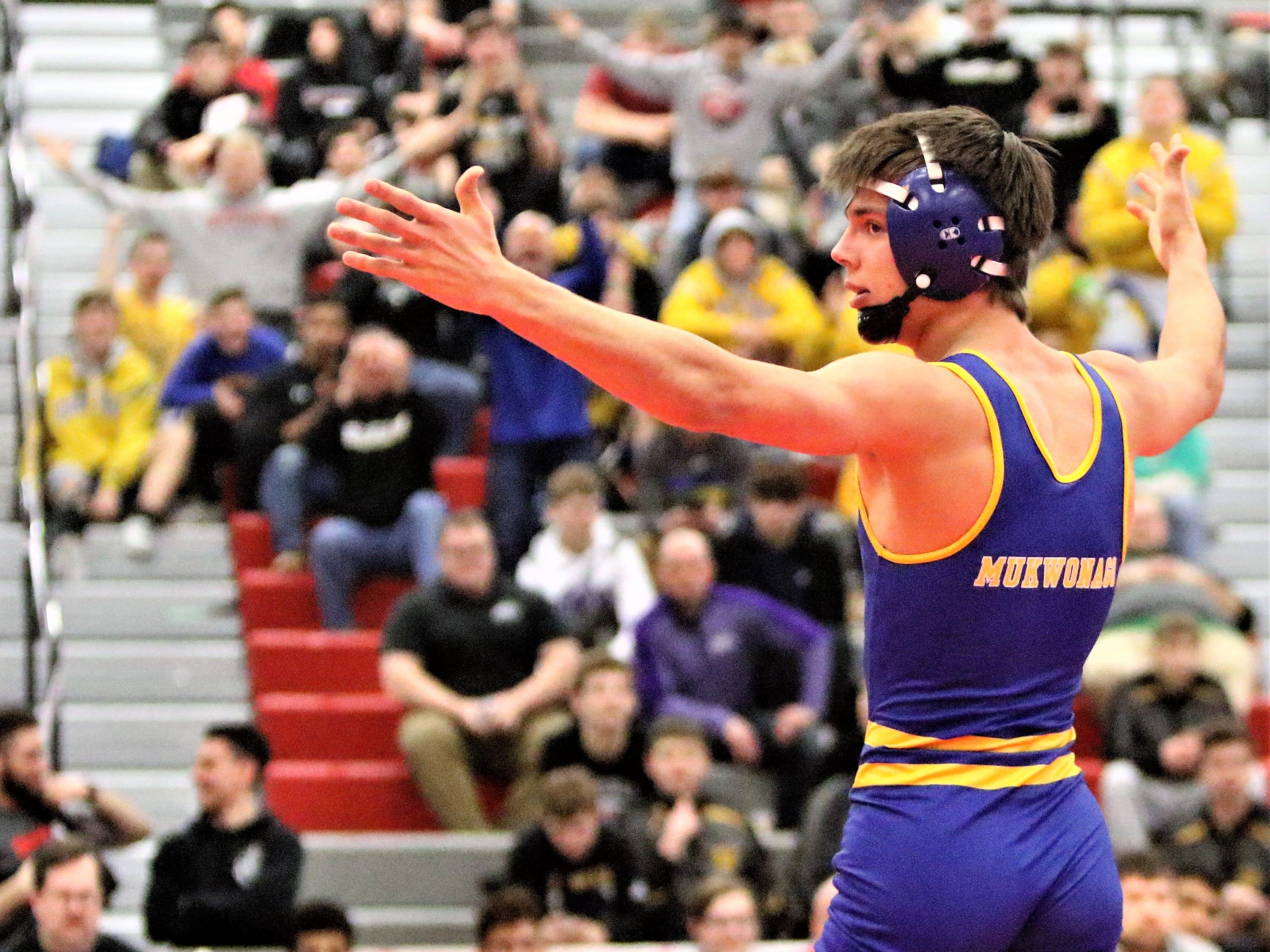 Mukwonago's Luke Eliszewski celebrates after winning the 126-pound sectional title at Racine Horlick on Feb. 16, 2019.