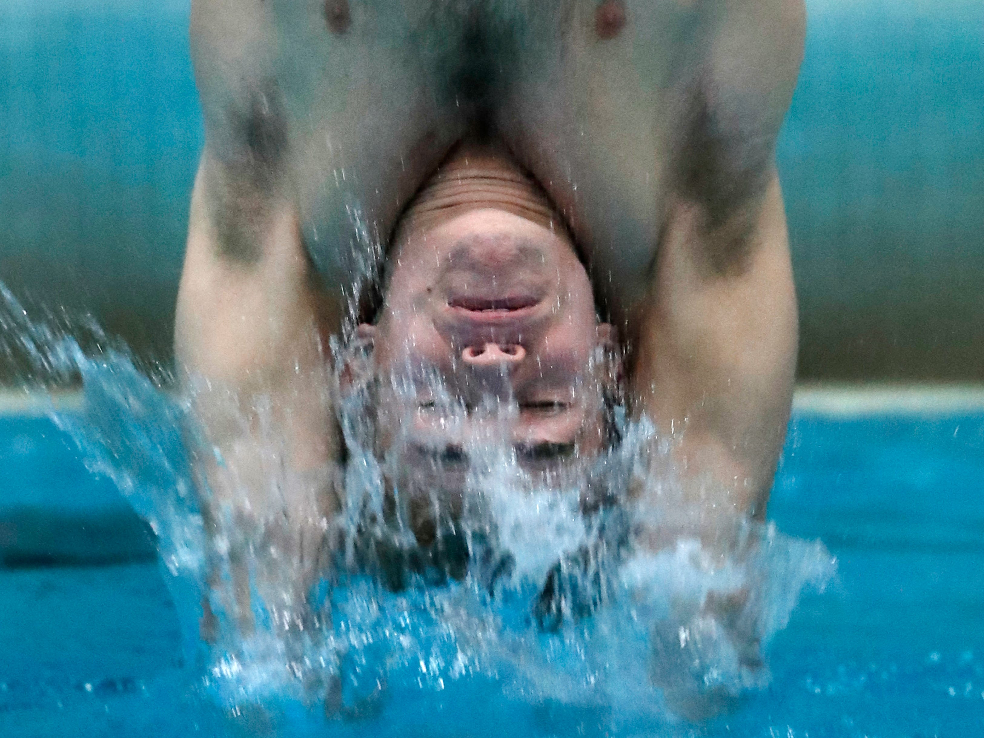 Franklin's Jared Kleczka hits the water during one of his dives at the WIAA Divisioln 1 state swimming and diving meet on Saturday at the UW Natatorium.