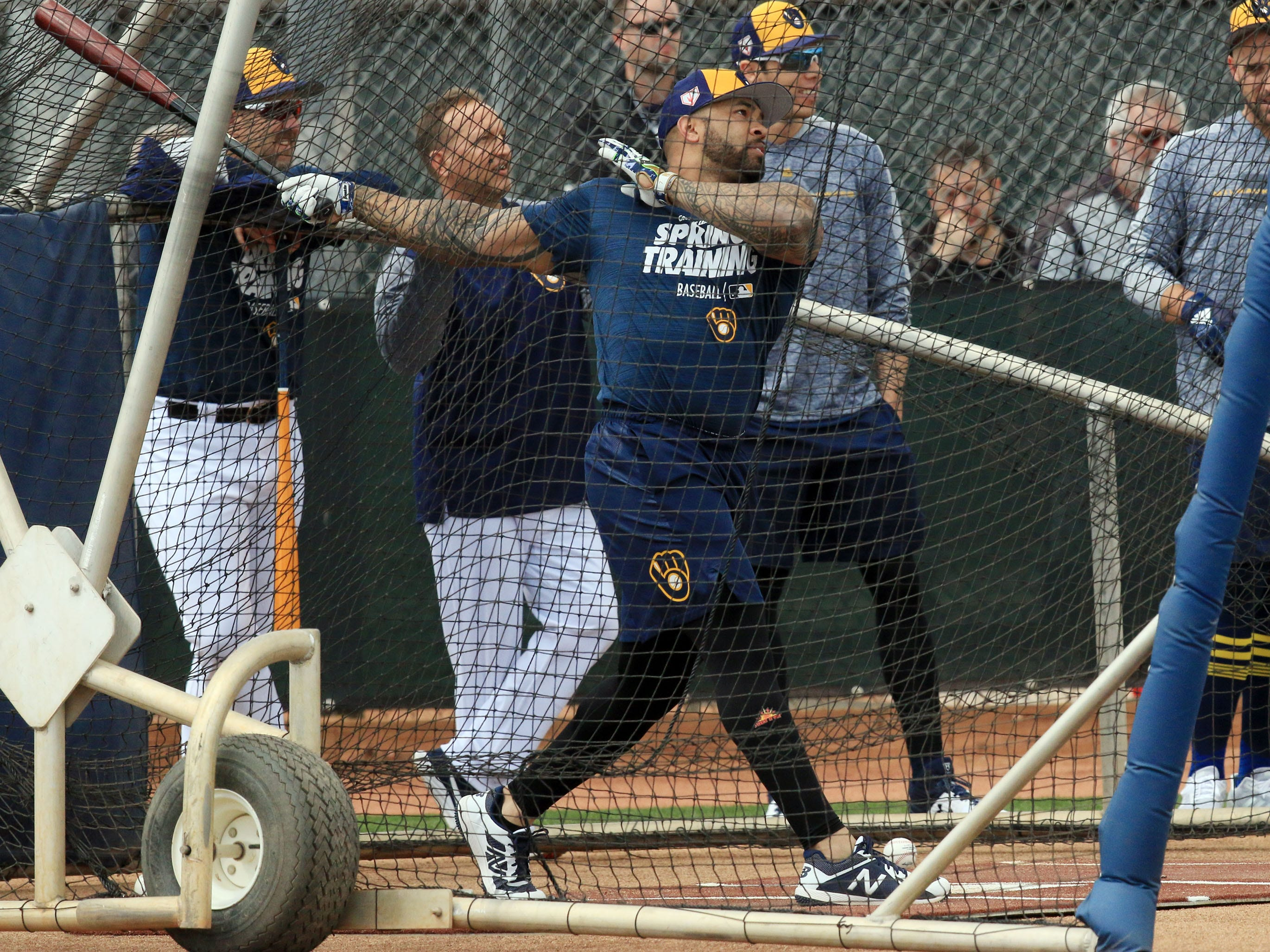 First baseman Eric Thames takes his cuts during batting practice on Saturday at the Brewers' newly renovated American Family Fields of Phoenix.