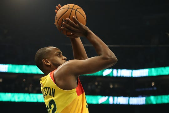 Khris Middleton hoists up a shot during the NBA all-star three-point competition Saturday night. The Bucks forward hit just eight of 25 shots and scored 11 points of a possible 34 to finish last among the 10 participants.