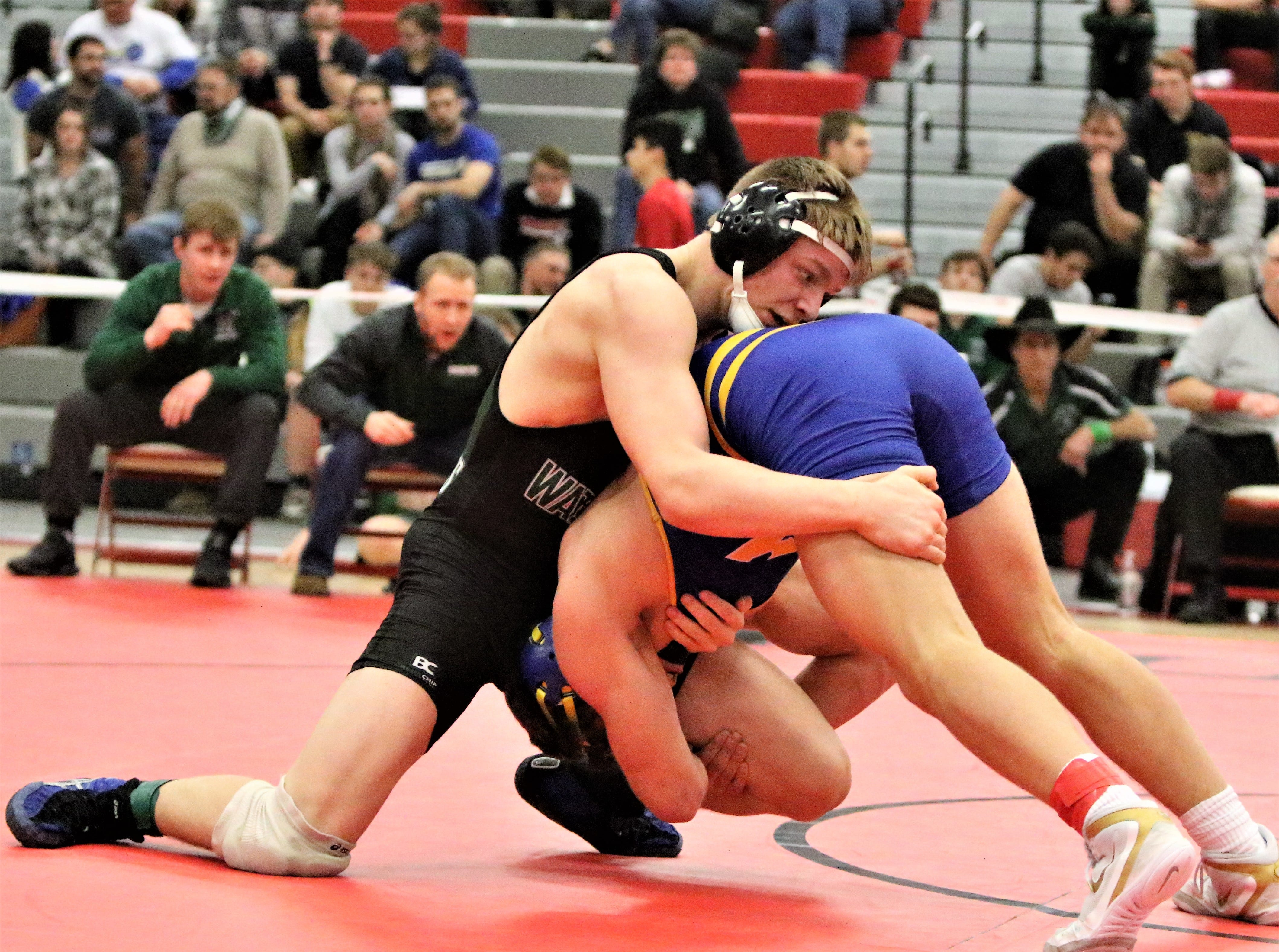 Waterford's Zach Kaminski (left) wrestles against Aaron Schmitz in the 170-pound sectional championship match at Racine Horlick on Feb. 16, 2019.