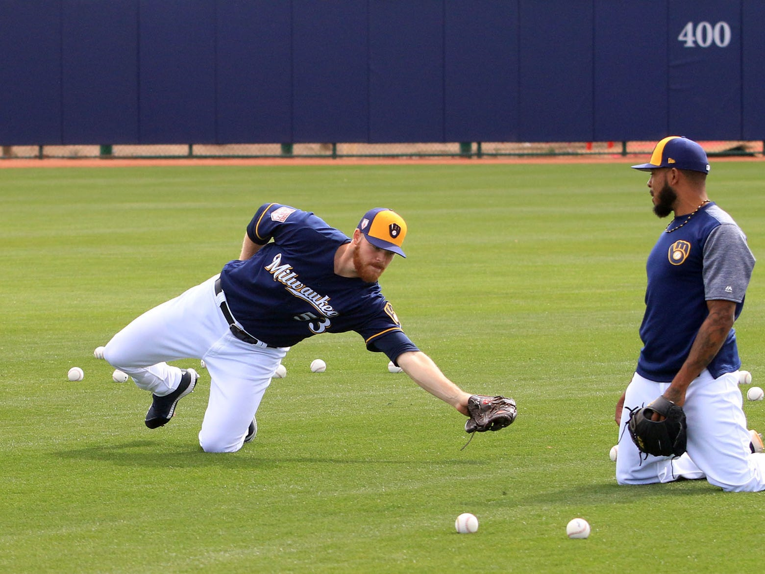 Brewers pitchers Josh Hader (from left), Brandon Woodruff and Jeremy Jeffress go through fielding drills on Saturday.