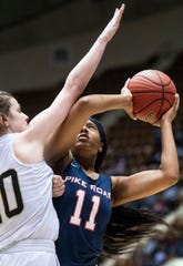 Pike Road's Eden Westry is defended by Straughn's Tori Hicks during AHSAA regional action Garrett Coliseum in Montgomery, Ala., on Saturday February 16, 2019.