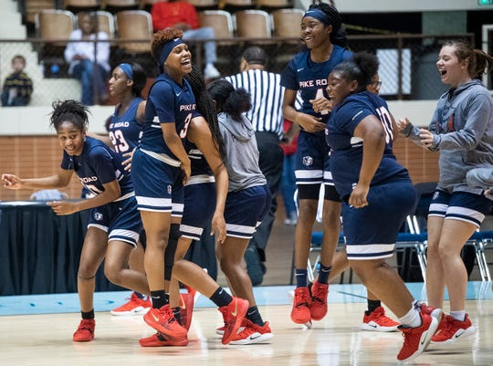 Pike Road players celebrate their overtime win over Straughn during AHSAA regional action Garrett Coliseum in Montgomery, Ala., on Saturday February 16, 2019.