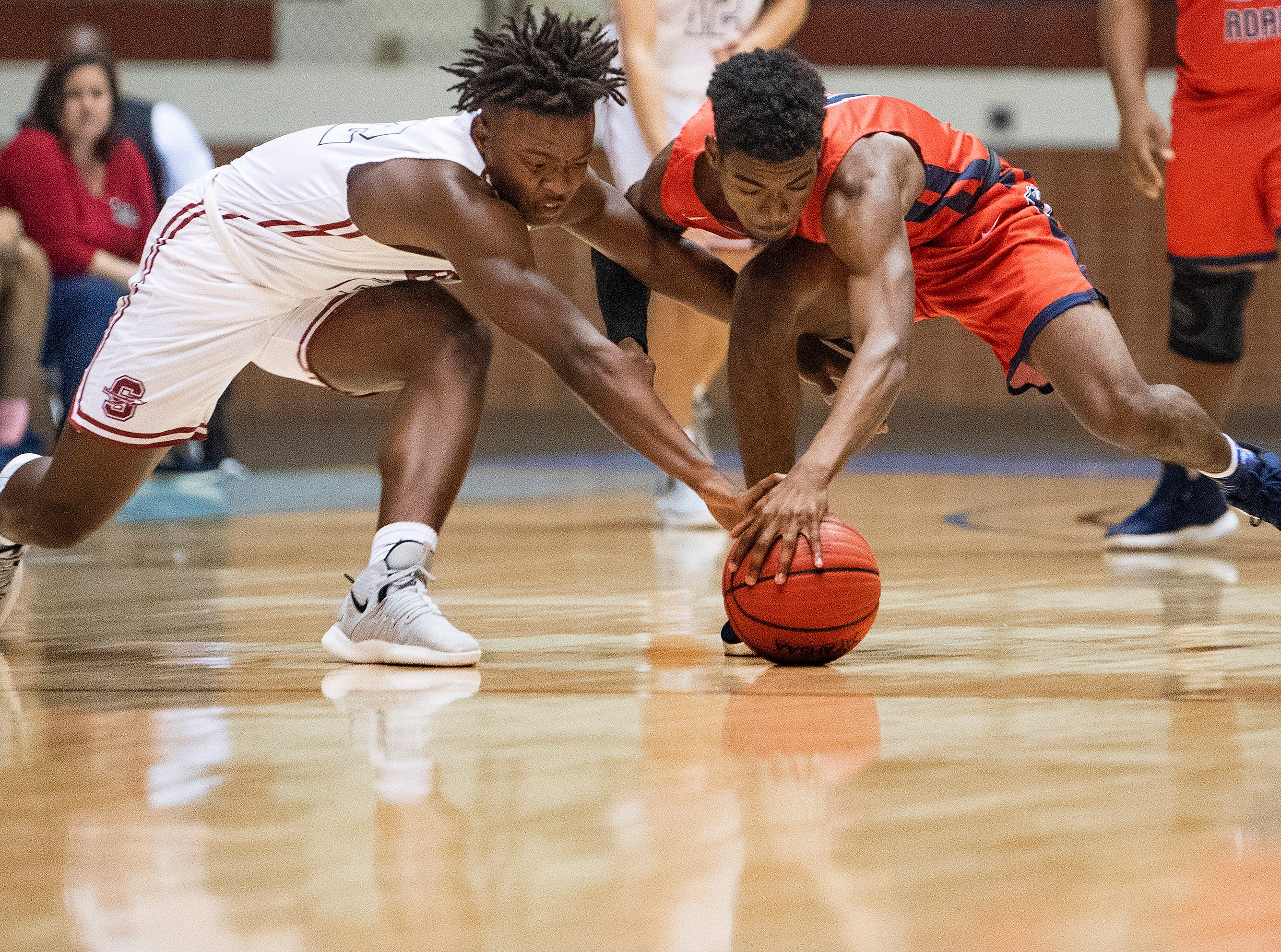 Slocomb's Jaylen Nobles and Pike Road's Jordan Davis chase a loose ball during AHSAA regional action Garrett Coliseum in Montgomery, Ala., on Saturday February 16, 2019.