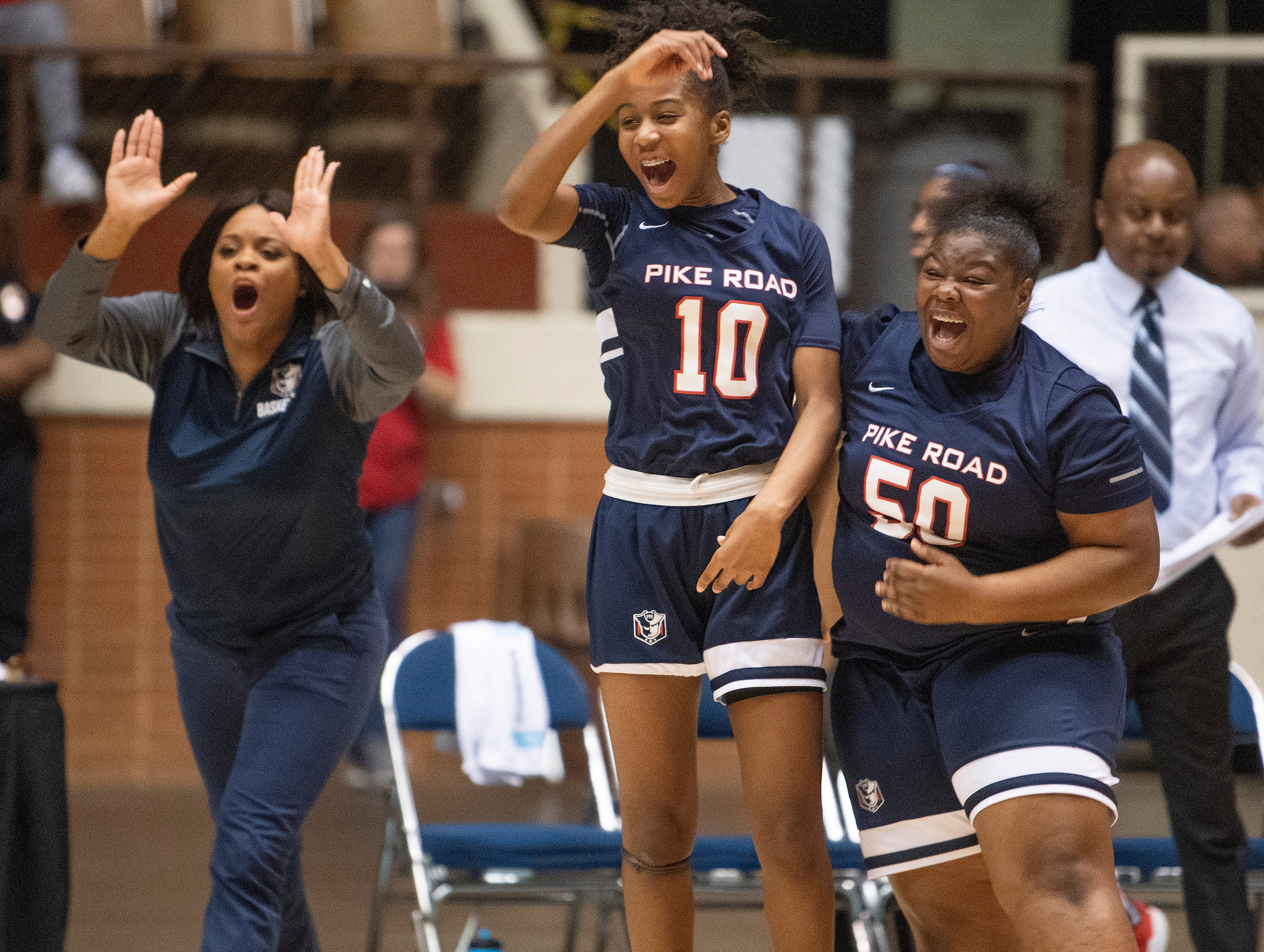 Pike Road's Jada Roberts and Chyna Patterson celebrate the overtime win over Straughn during AHSAA regional action Garrett Coliseum in Montgomery, Ala., on Saturday February 16, 2019.