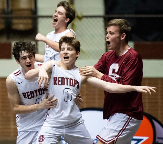 Slocomb's Braydon Whitaker celebrates with teammates after scoring the winning goal as time runs out against Pike Road during AHSAA regional action Garrett Coliseum in Montgomery, Ala., on Saturday February 16, 2019.