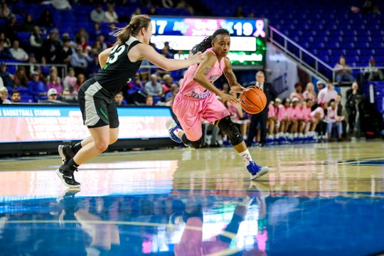 MTSU guard A'Queen Hayes drives towards the basket during the Lady Raiders' 59-53 loss to Marshall on Feb. 16, 2019