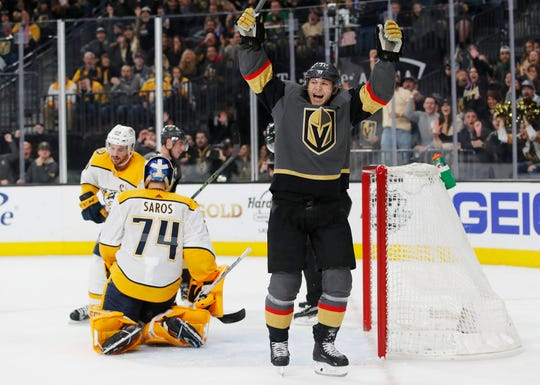 Vegas Golden Knights' William Karlsson celebrates after teammate Brandon Pirri scored against the Nashville Predators during the second period of an NHL hockey game Saturday, Feb. 16, 2019, in Las Vegas. (AP Photo/John Locher)