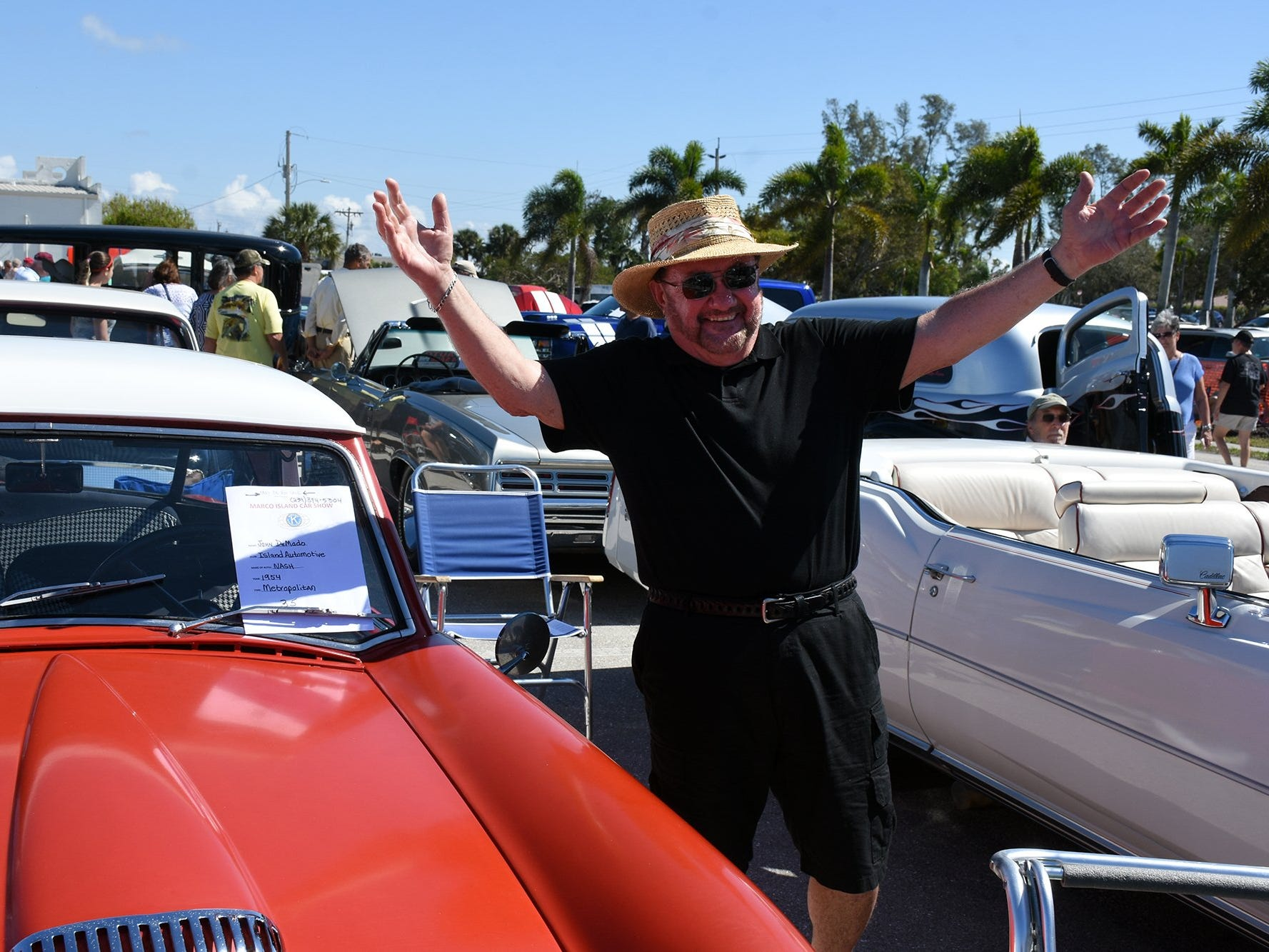 "John DeMado reacts to applause for his ""horn solo"" on ""Beep Beep,"" the 1959 classic by the Playmates. The annual Kiwanis car show brought 170 collectible cars and thousands of car enthusiasts to Veterans Community Park on Marco Island Sunday."
