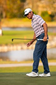 Ken Tanigawa reacts to his putt during the second round of the Chubb Classic at The Classics at Lely Resort on Saturday. Tanigawa is tied with Stephen Ames and Glen Day for the lead.