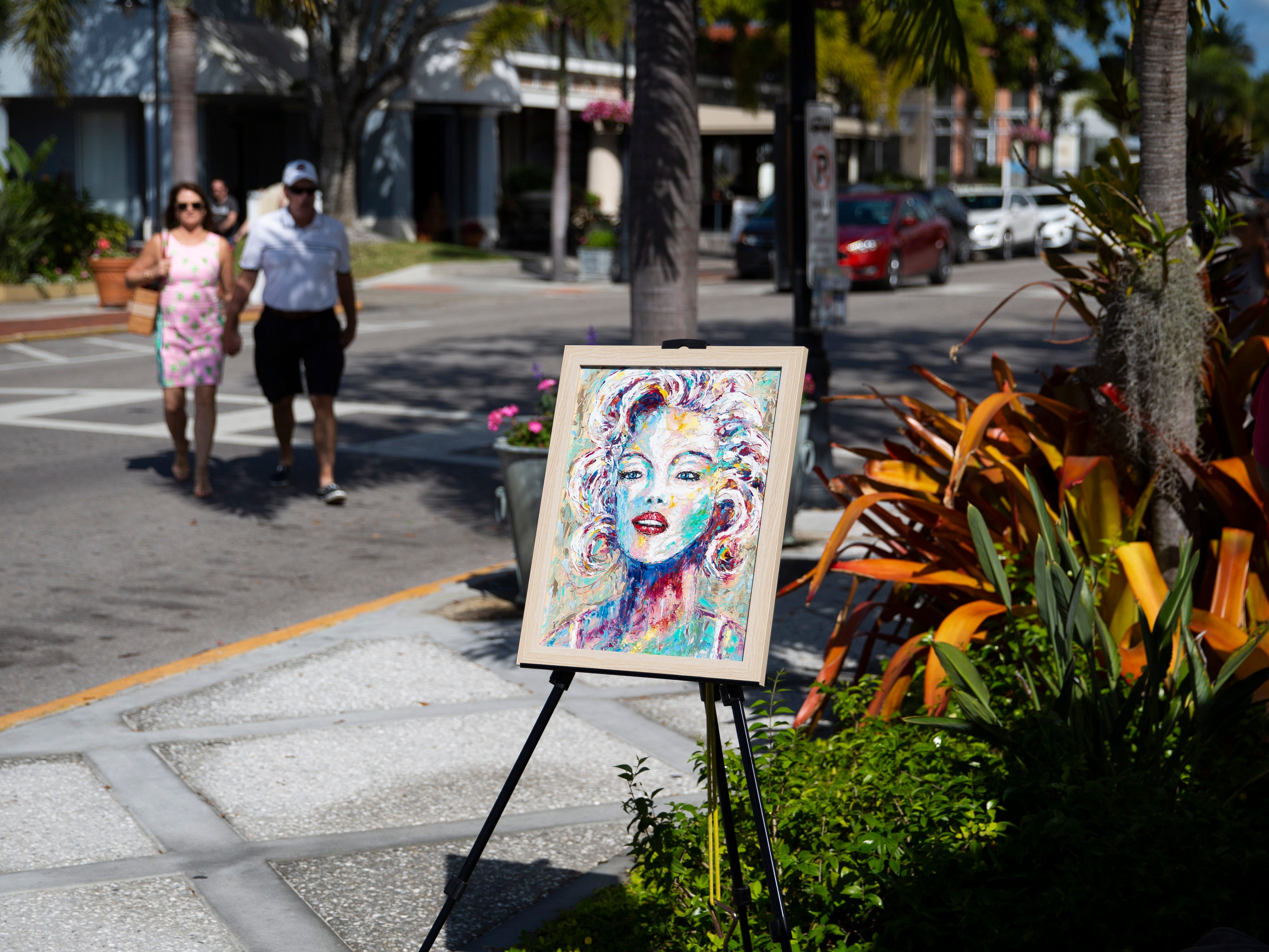 A painting by Ken Fraser sits on display during the annual Third on Canvas event on Third Street South in Naples on Sunday, Feb. 17, 2019.