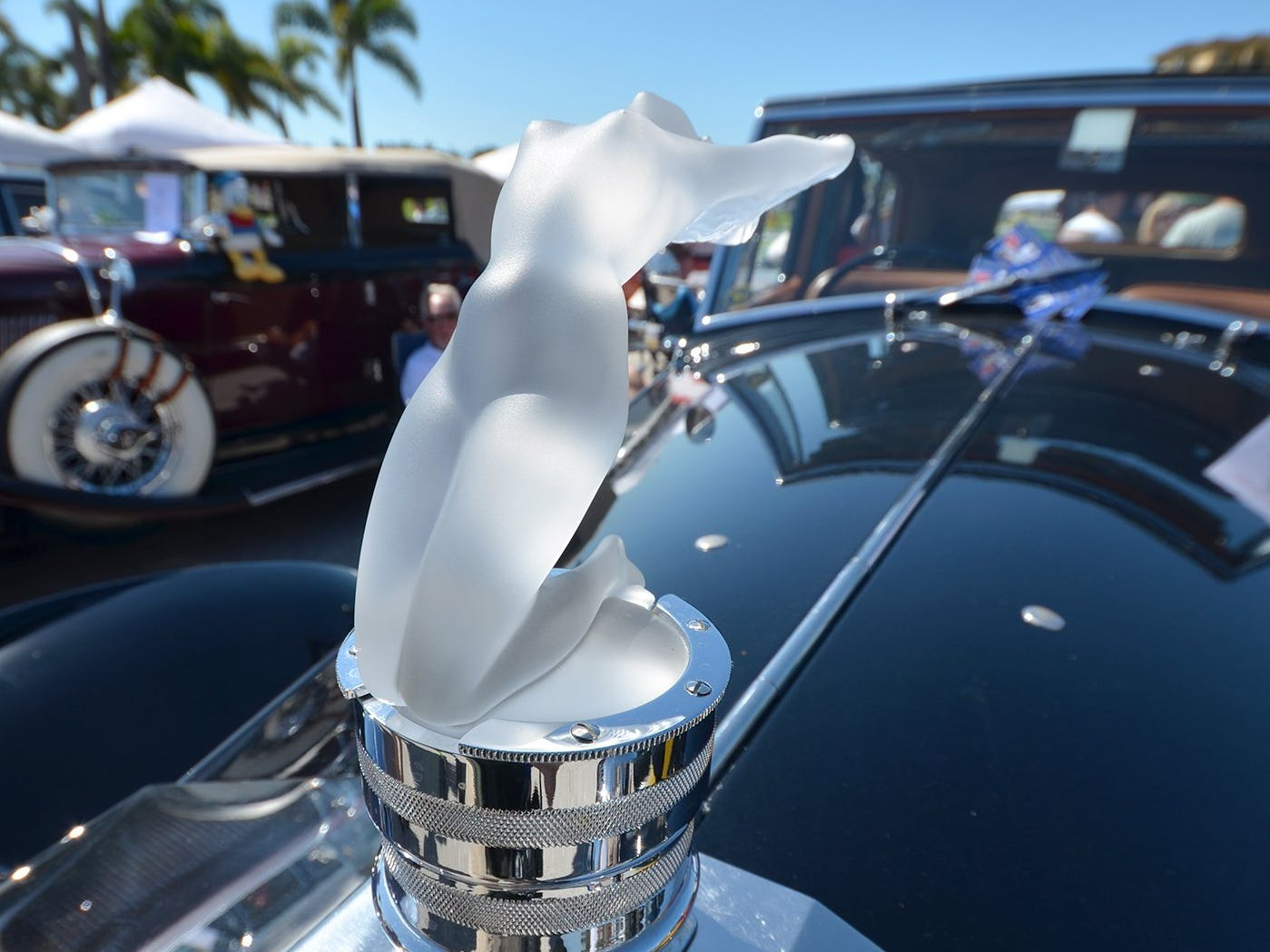 The Lalique hood ornament on Sal and JoAnn Campo's Rolls Royce lights up at night. The annual Kiwanis car show brought 170 collectible cars and thousands of car enthusiasts to Veterans Community Park on Marco Island Sunday.