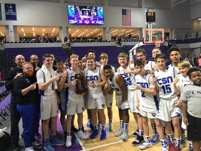 The Community School boys basketball team celebrates its Class 5A-District 10 championship following a 57-31 win over LaBelle at Suncoast Credit Union Arena in Fort Myers on Saturday.