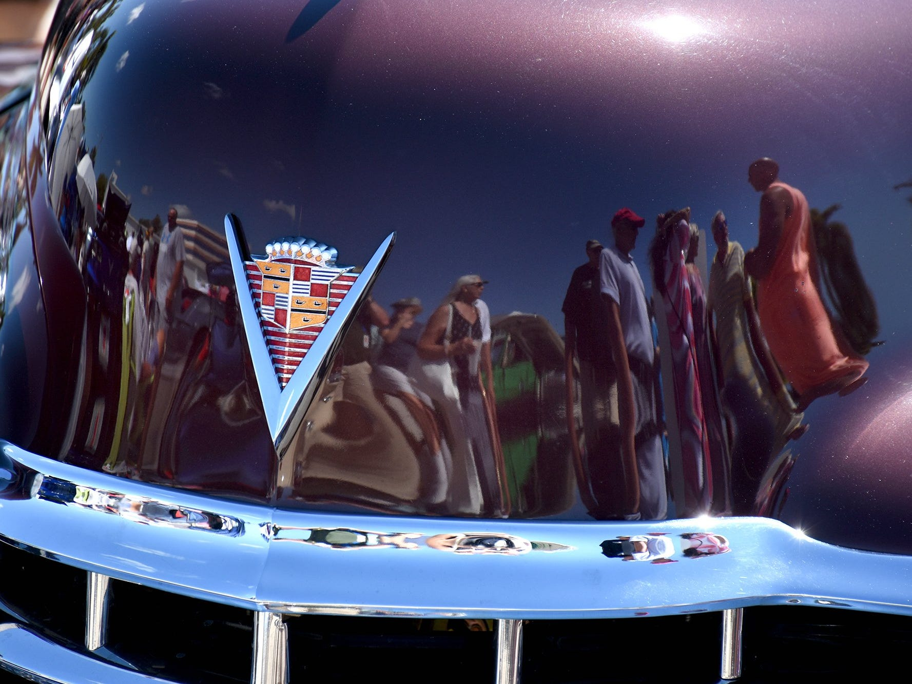 Spectators are reflected in John Yurconic's 1947 Cadillac. The annual Kiwanis car show brought 170 collectible cars and thousands of car enthusiasts to Veterans Community Park on Marco Island Sunday.