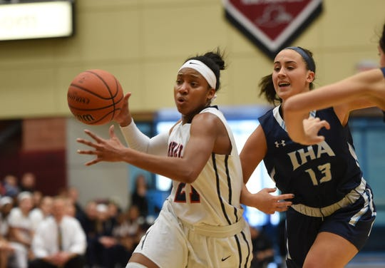 Sydnei Caldwell (no.21) of Saddle River Day makes her way past Eden Plescia (no.13) of Immaculate Heart Academy in the second half during the Bergen County girls basketball final at Ramapo College in Mahwah on 02/17/19.