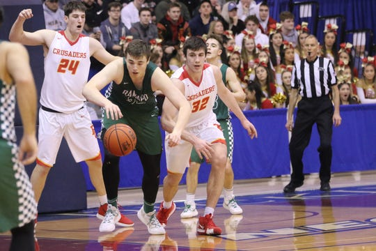 Neal Quinn, of Ramapo, tries to break away from Bergen Catholic, during the first half of their, Bergen County Jamboree Semifinals game. Sunday, February 17, 2019
