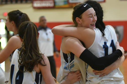 Stephanie LaGreca (facing) and Sam Matin (11) share a hug after helping Wayne Valley defeat Kennedy in Saturday's Passaic County girls basketball semifinals.